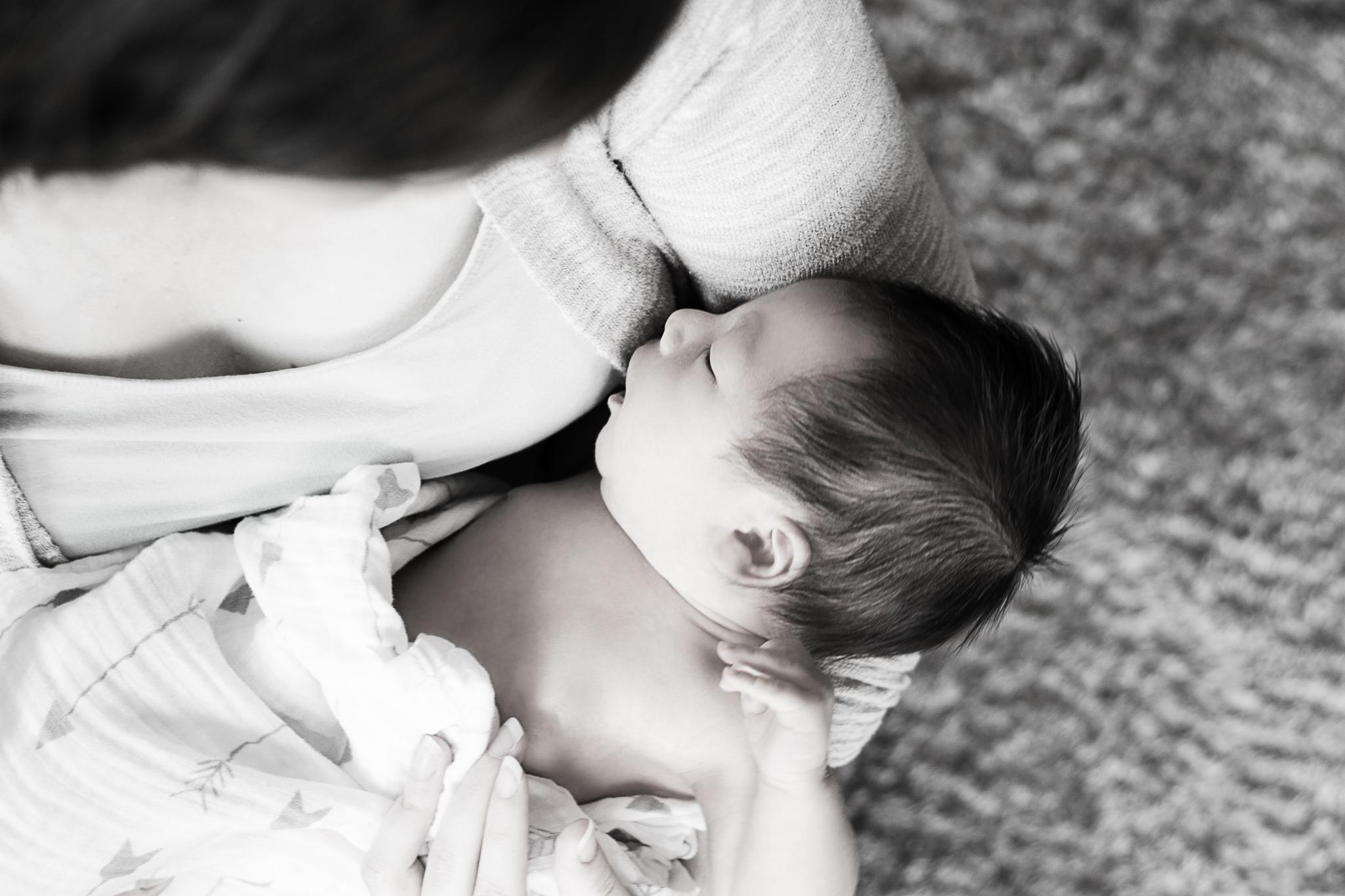 mom cradling newborn baby in Portland, Oregon