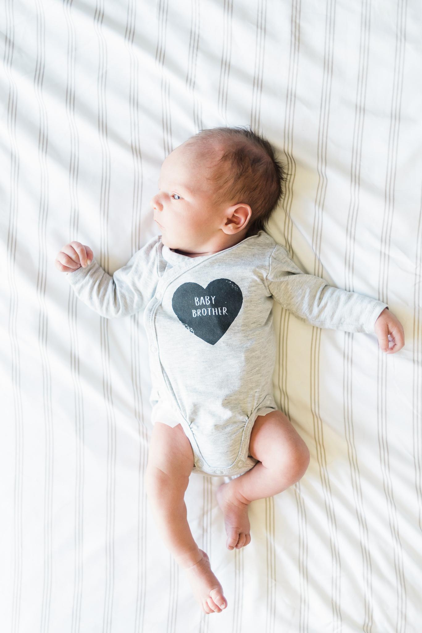 newborn baby boy on bed, portland oregon, hillsboro oregon, in home newborn session, baby boy, portland newborn photographer