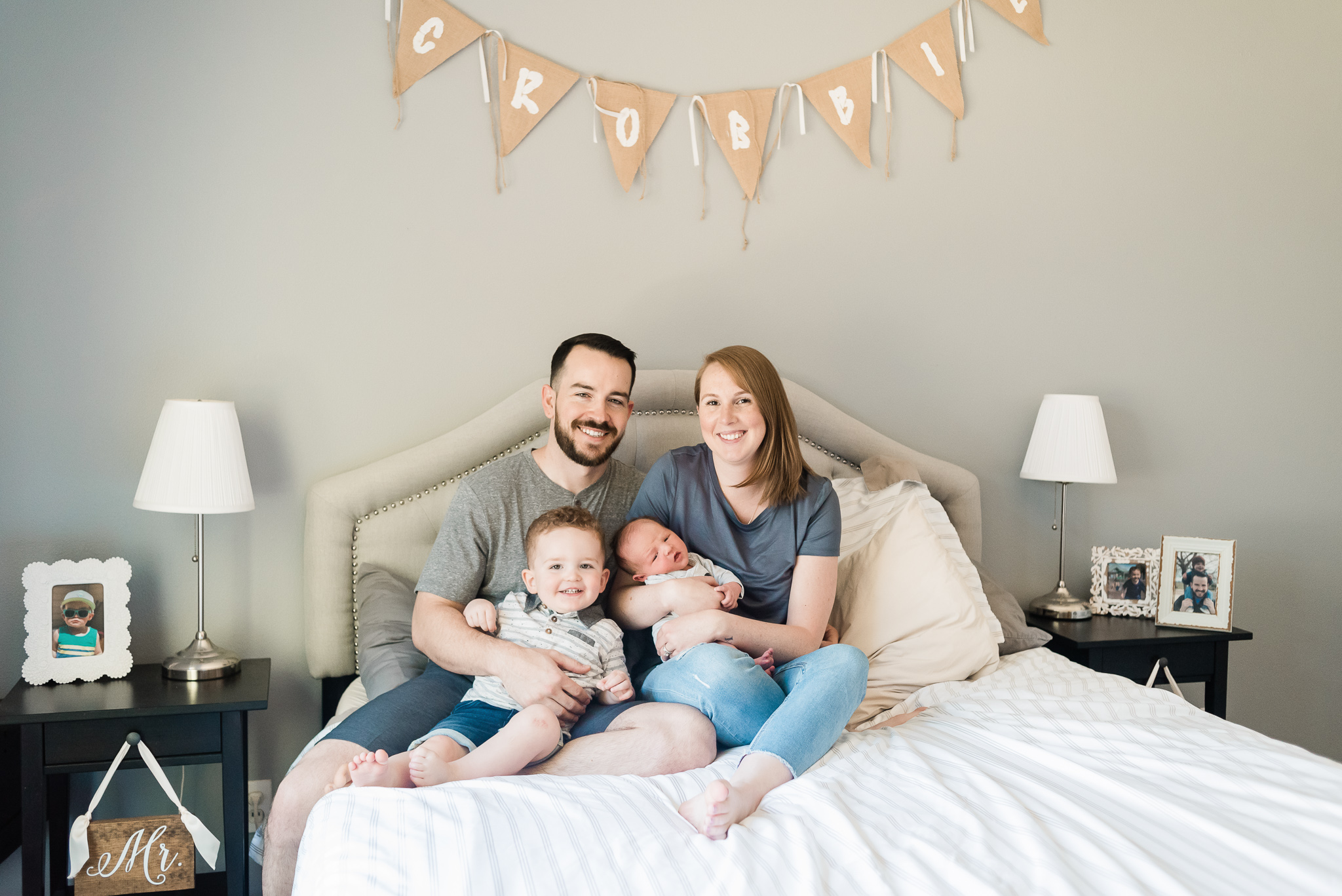 Family sitting on a bed, newborn lifestyle photography, portland oregon, hillsboro oregon, in home newborn session, baby boy, portland newborn photographer