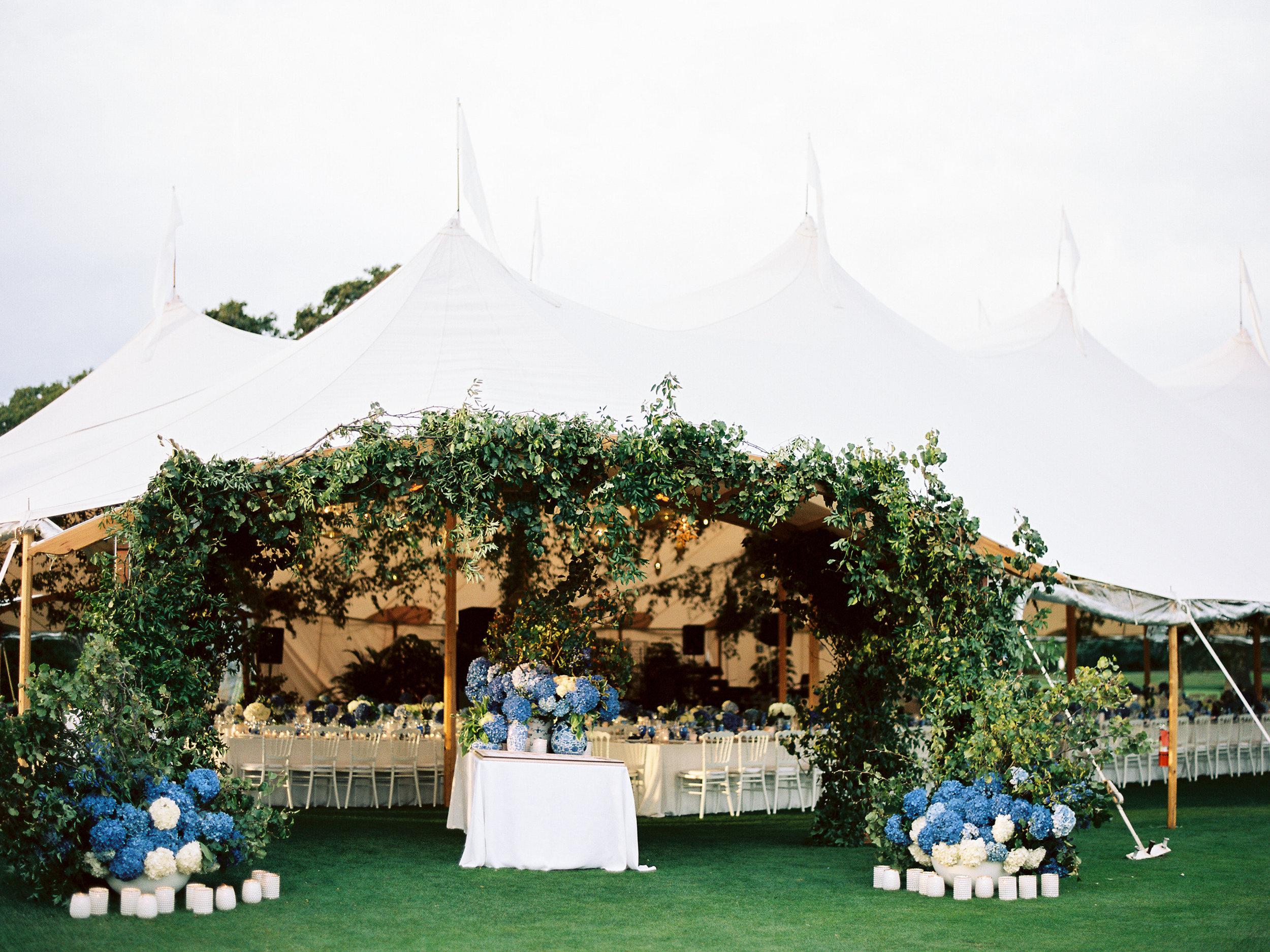 Sperry Tent Wedding, Sail cloth Tent Wedding, Blue Hydrangea, Escort Card Table, Smilax, Candles, Coastal Chic Wedding, Nicole Simeral Wedding Planner