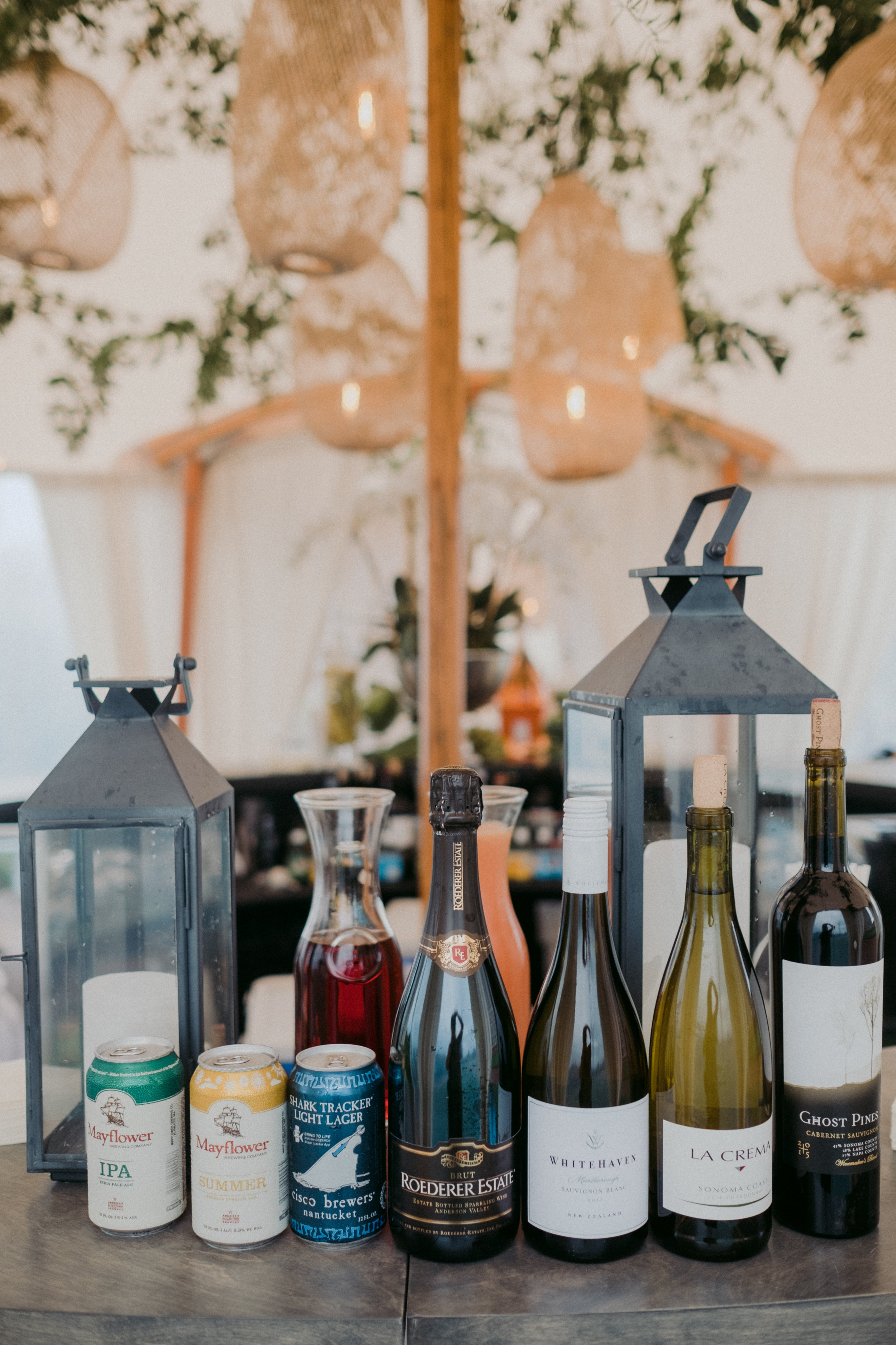 Same Sex Wedding in Provincetown, MA. Destination wedding planned by Nicole Simeral. Coastal Chic Wedding, Travel Wedding, Sperry Sailcloth Tent Wedding.  Getting Ready, Rain, Rainbow, Miracle , smilax vine, straw lanterns