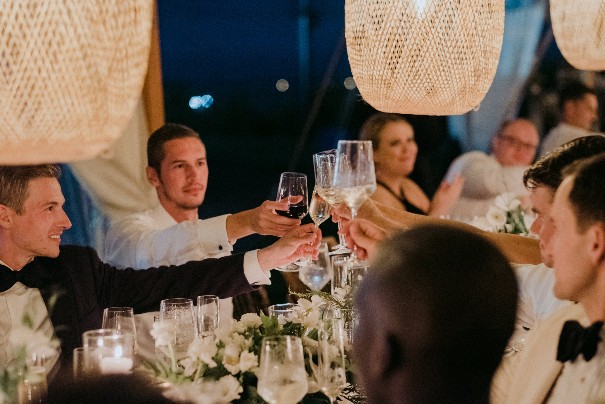 Same Sex Wedding in Provincetown, MA. Destination wedding planned by Nicole Simeral. Coastal Chic Wedding, Travel Wedding, Sperry Sailcloth Tent Wedding, bamboo folding chairs, Belfast linen, whites and greens , straw lantern, candlelight, toast, groomsmen