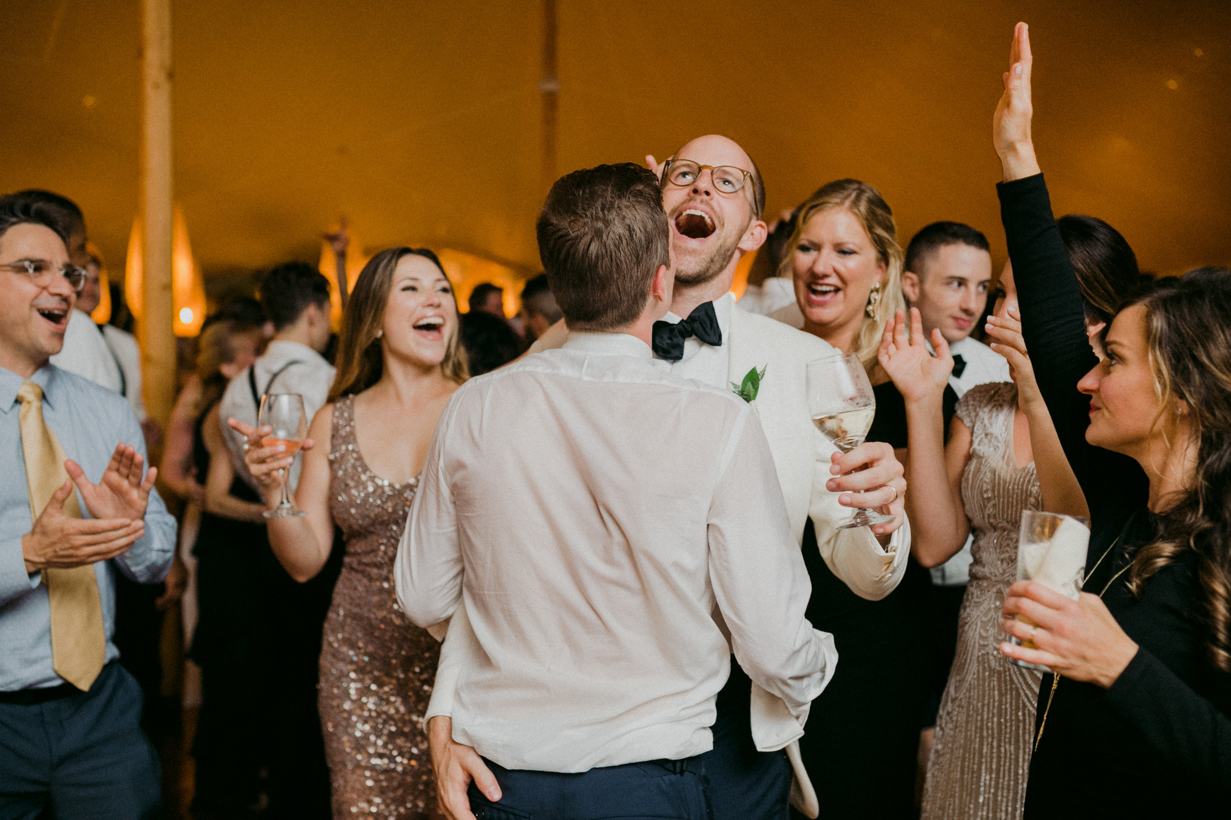 Same Sex Wedding in Provincetown, MA. Destination wedding planned by Nicole Simeral. Coastal Chic Wedding, Travel Wedding, Sperry Sailcloth Tent Wedding, grooms, dancing, candle light, warm lighting.
