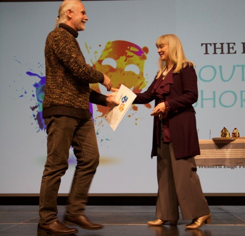 David Rawet receives his Finalists certificate from Therese Edmonds, producer