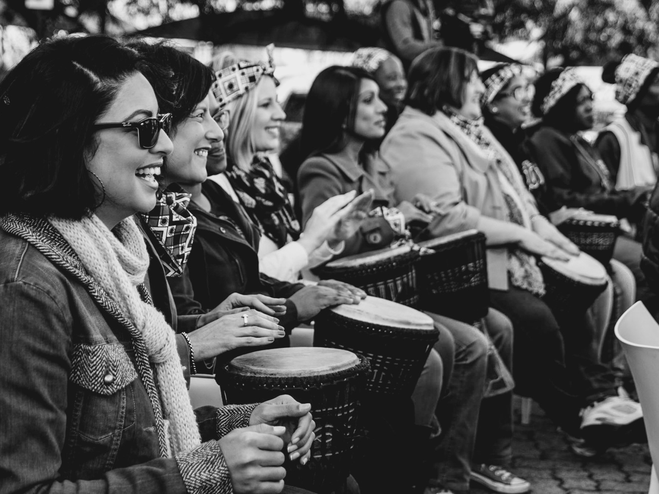 women-drumming-and-smiling-black-and-white.jpg