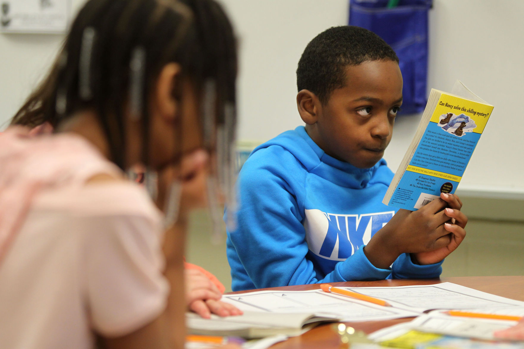 """Caysen Harris, a second-grader at Corinth Elementary School, follows along as his reading group reads """"Nancy Drew and The Clue Crew"""" by Carolyn Keene, with their teacher, Cindy Wilbanks.   Adam Robison/Northeast Mississippi Daily Journal"""
