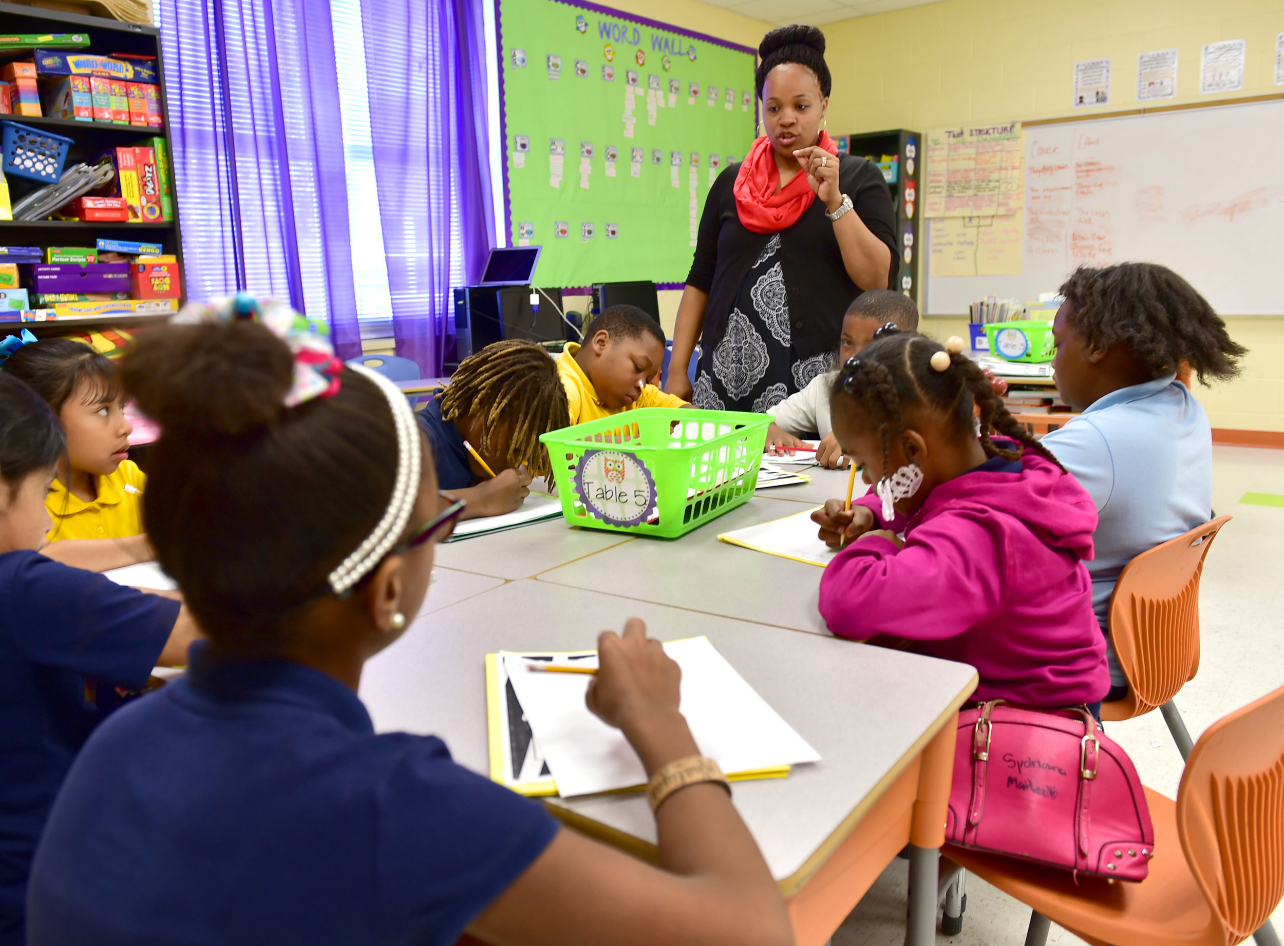 In this file photo, reading coach Lakisha Watkins practices word sounds and spelling with third-graders at Goodloe Elementary School in Canton. As Mississippi prepares to raise the bar for its third-grade literacy promotion test, there's an increasing demand for such positions. Advocates say investing more in the state's public schools could help grow a state-funded reading coach program.   File Photo/Clarion Ledger