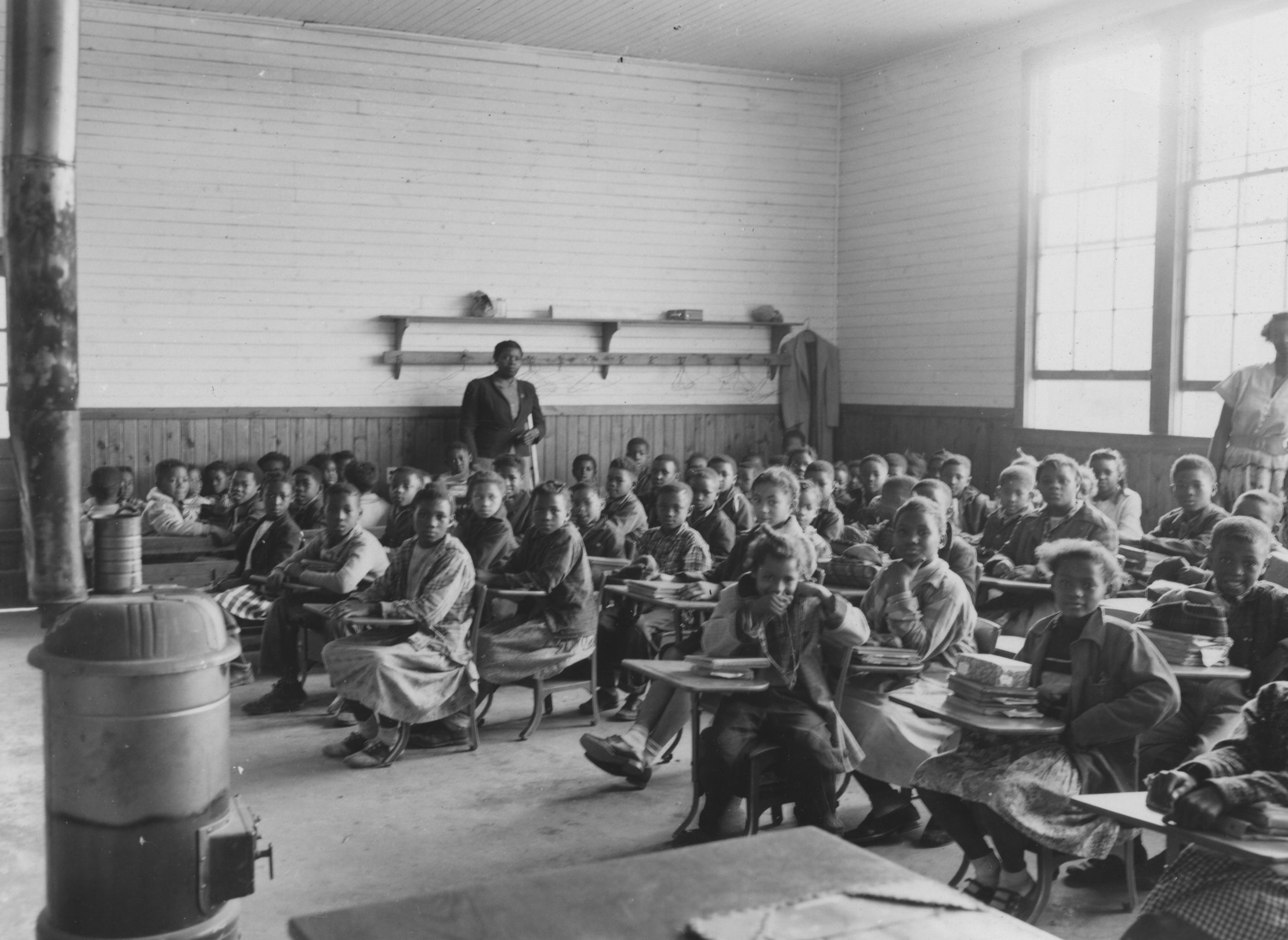 The only heat for students in the Sherman Creek Elementary School in Tallahatchie County in 1955 was the wood heater in the middle of the room.   John E. Phay collection at the University of Mississippi Libraries Digital Collections