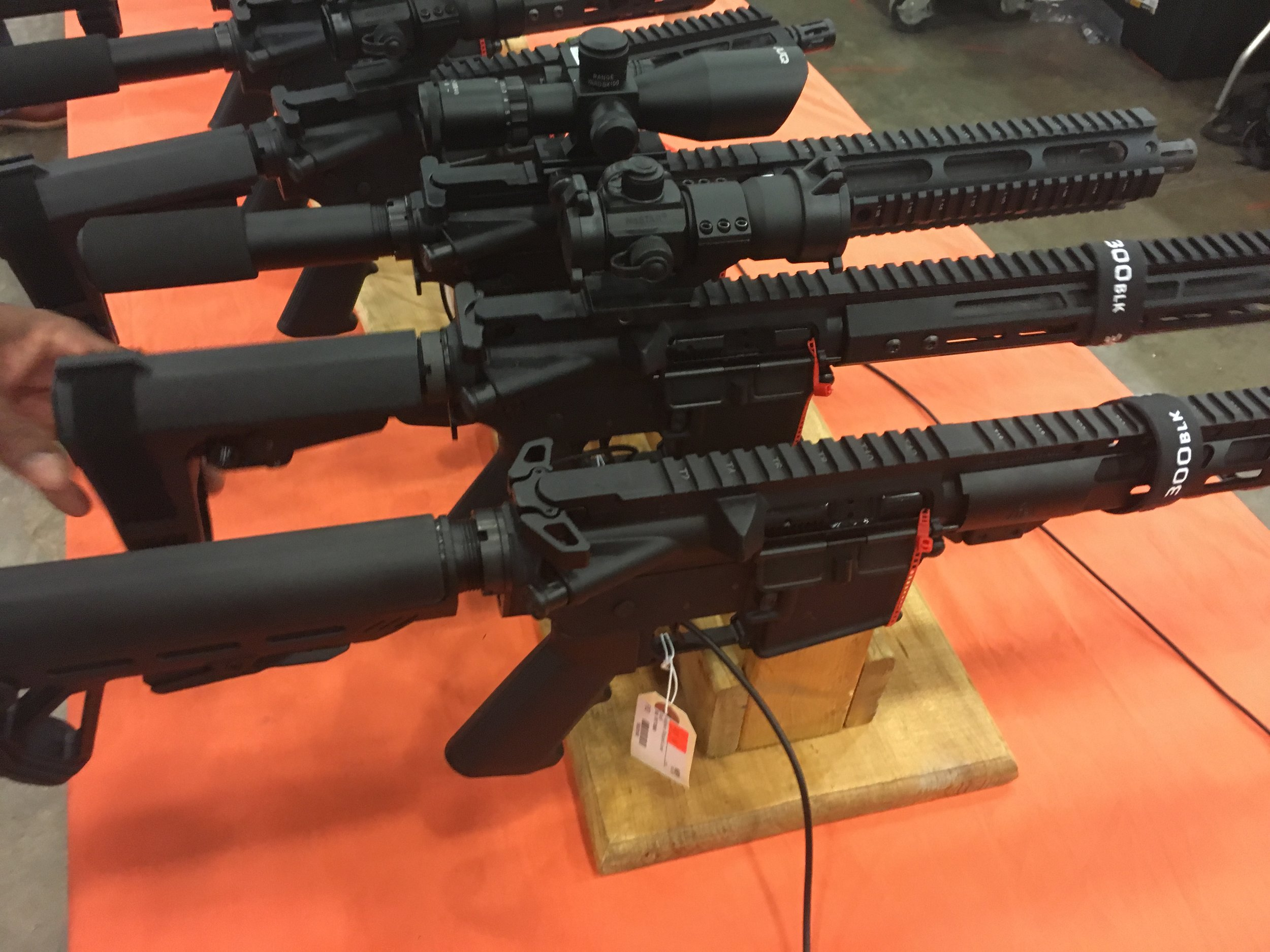 Some of the items in high demand at a gun show in Jackson, Mississippi, are pistols that are equipped with several accessories — such as a high-capacity magazine — making them similar to short rifles, but without the same federal regulations.   Justin Vicory/Mississippi Center for Investigative Reporting