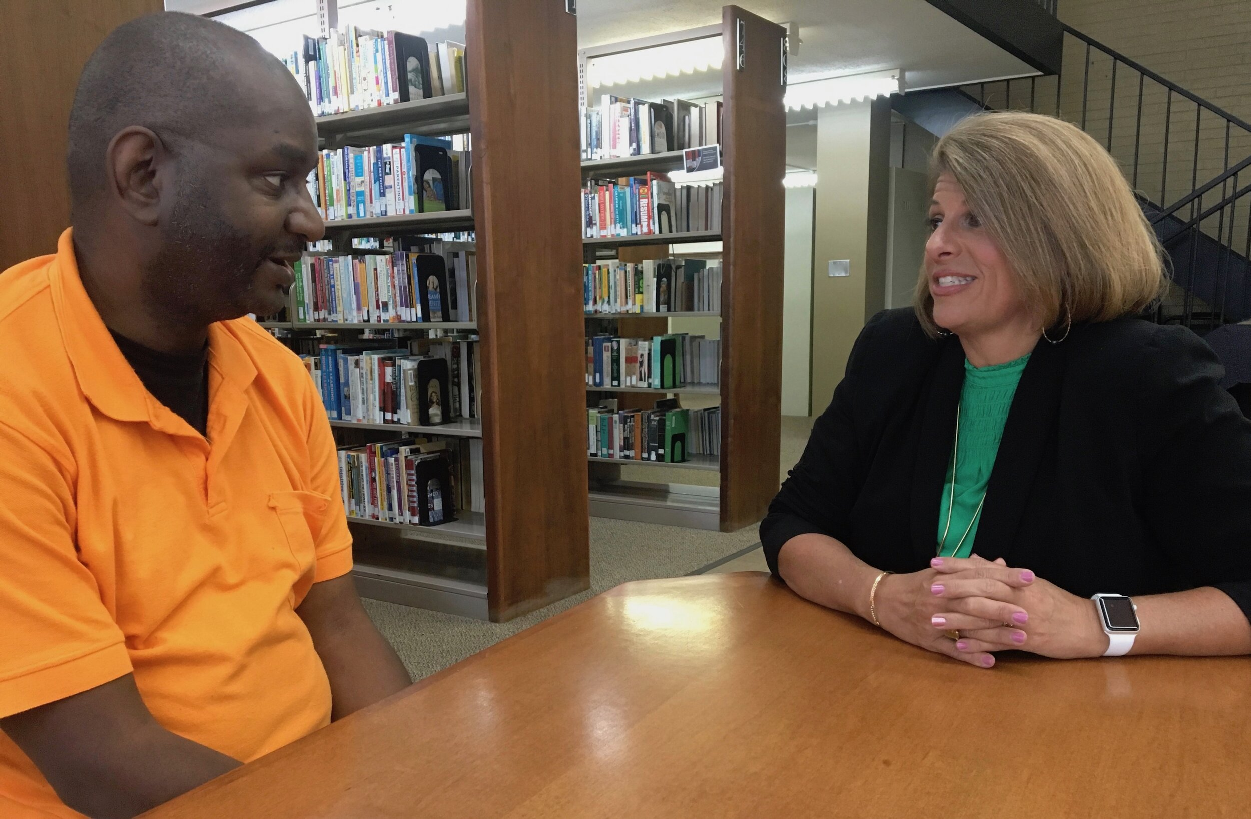 Bobby Thomas talks with his mentor, Angela Ladner, executive director of the Mississippi Psychiatric Association.   Billy Watkins/Mississippi Center for Investigative Reporting