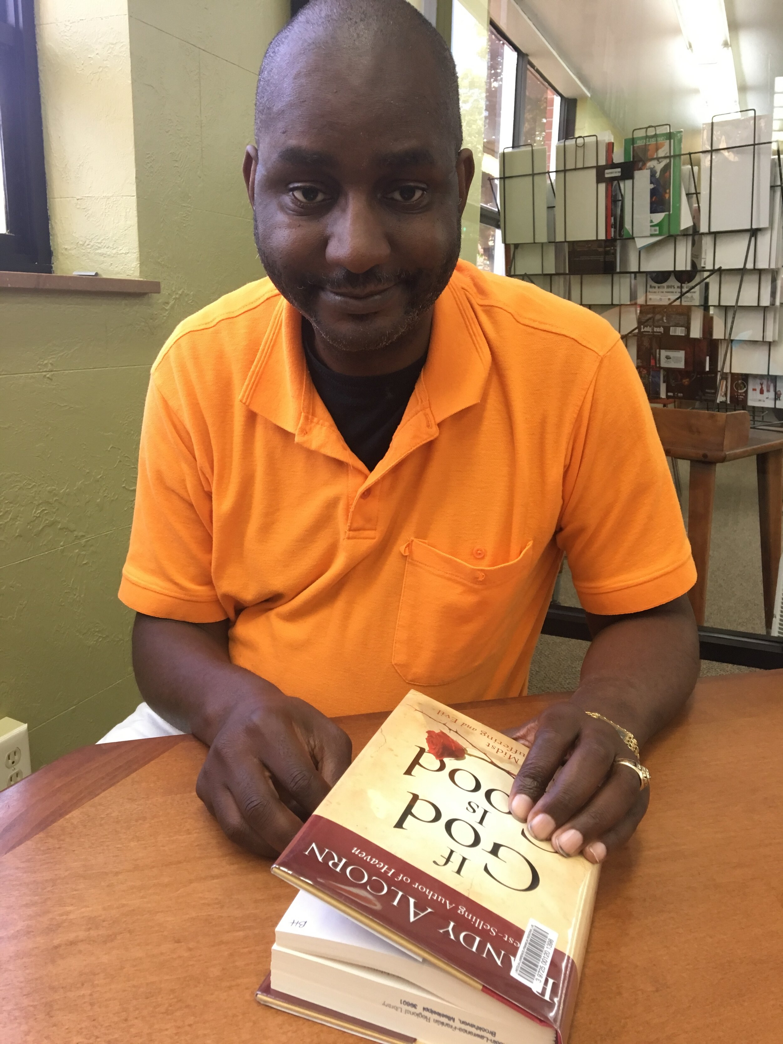 Bobby Thomas finds peace in listening to the Mississippi Mass Choir and reading books about religion.   Billy Watkins/Mississippi Center for Investigative Reporting