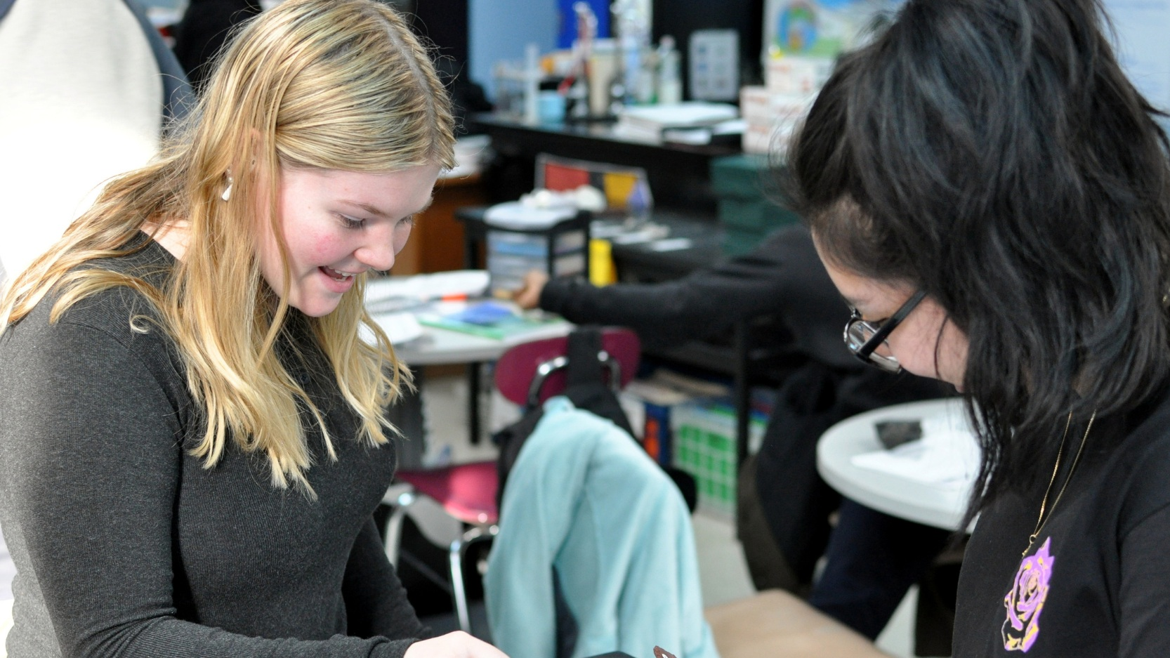 At Murray Hill Academy, students work collaboratively in Socratic Seminars, Literature Circles, Student Led Discussions, and Exploratory Labs. Pictured here are two students collaborating on a lab to identify differe (1).png