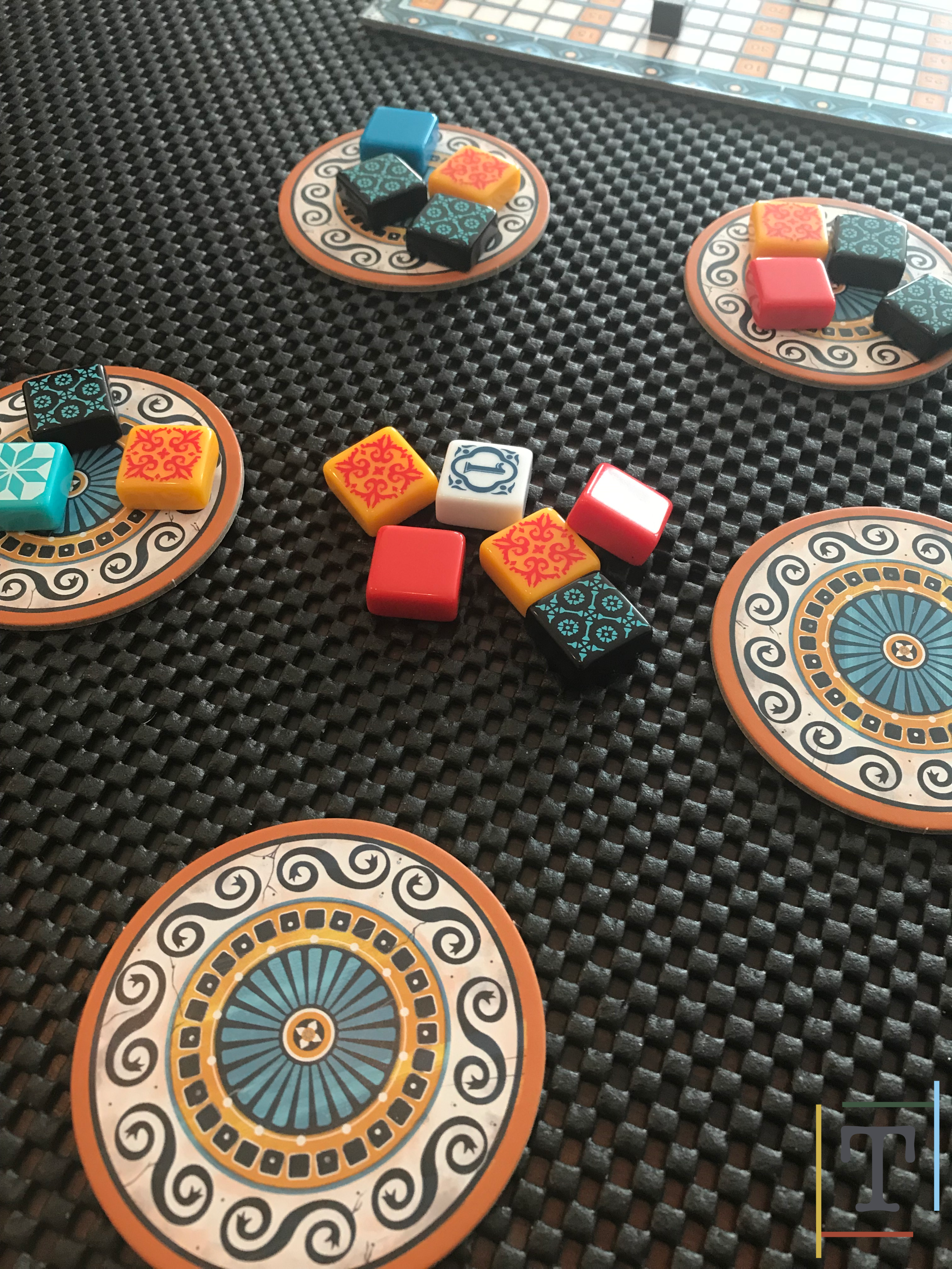 Players choose tiles from the factories or the middle of the factory area