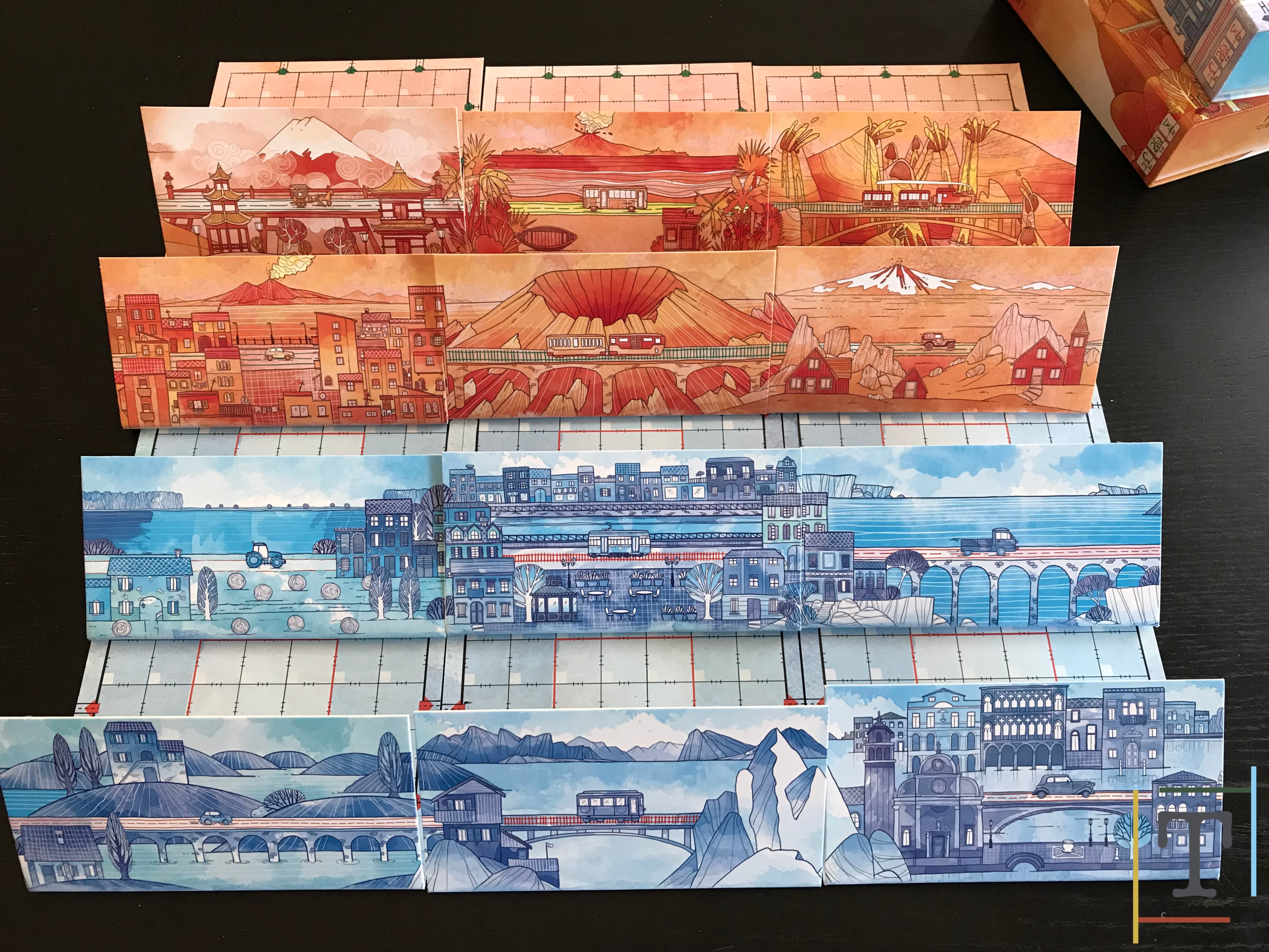 The backs of the player boards line up to make a beautiful panorama
