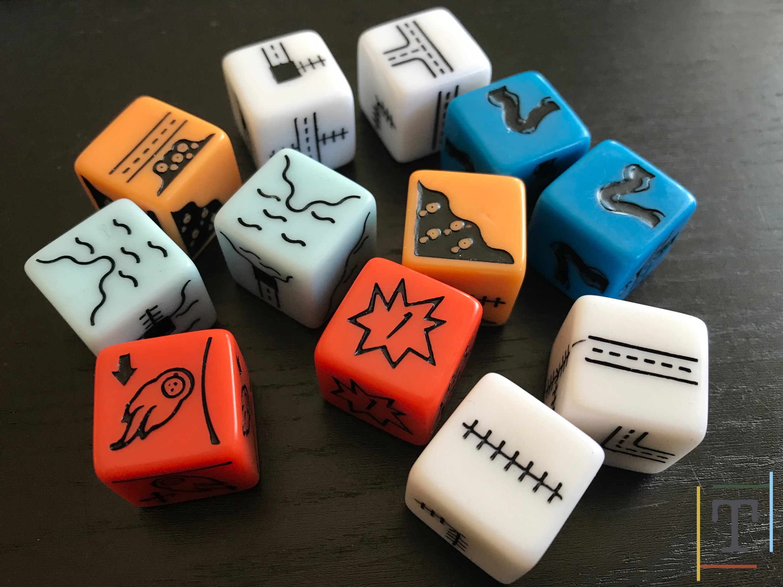 The base game dice (white) and the four sets of expansion dice