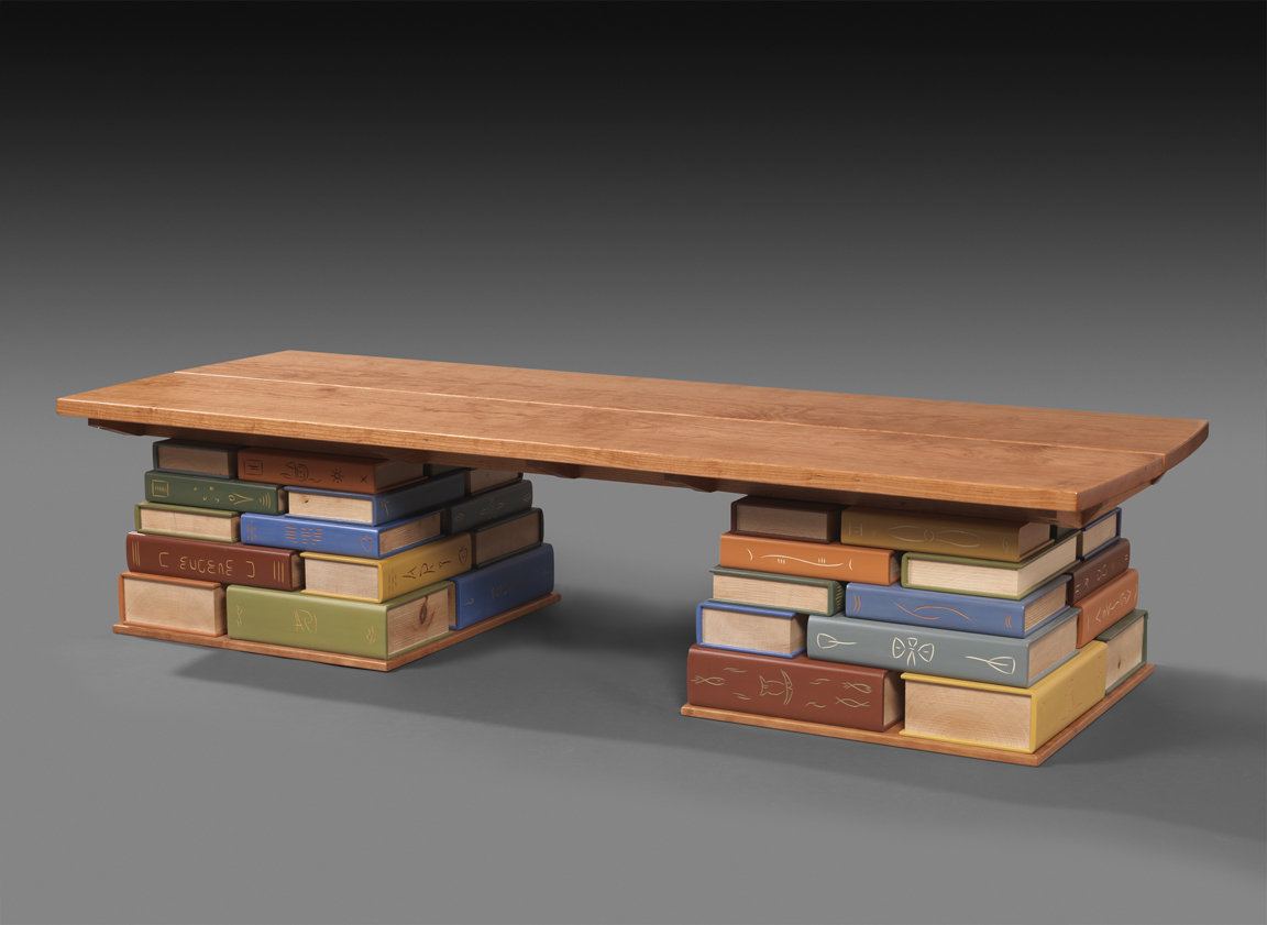 """Book Bench - Carved and painted Basswood and Soft Maple, Cherry seat and footings. 18""""H x 80""""W x 28""""DCommissioned for the Kent Memorial Library in Suffield, Connecticut"""