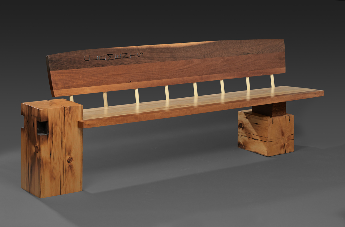 Clements Door Bench - The seat and back are cut from a door to Stewart Clements' previous studio. Since he was raised in the south I thought it would be nice to add some Southern Yellow Pine blocks to the design.Stewart is the photographer who created all of the wonderful images on my site.