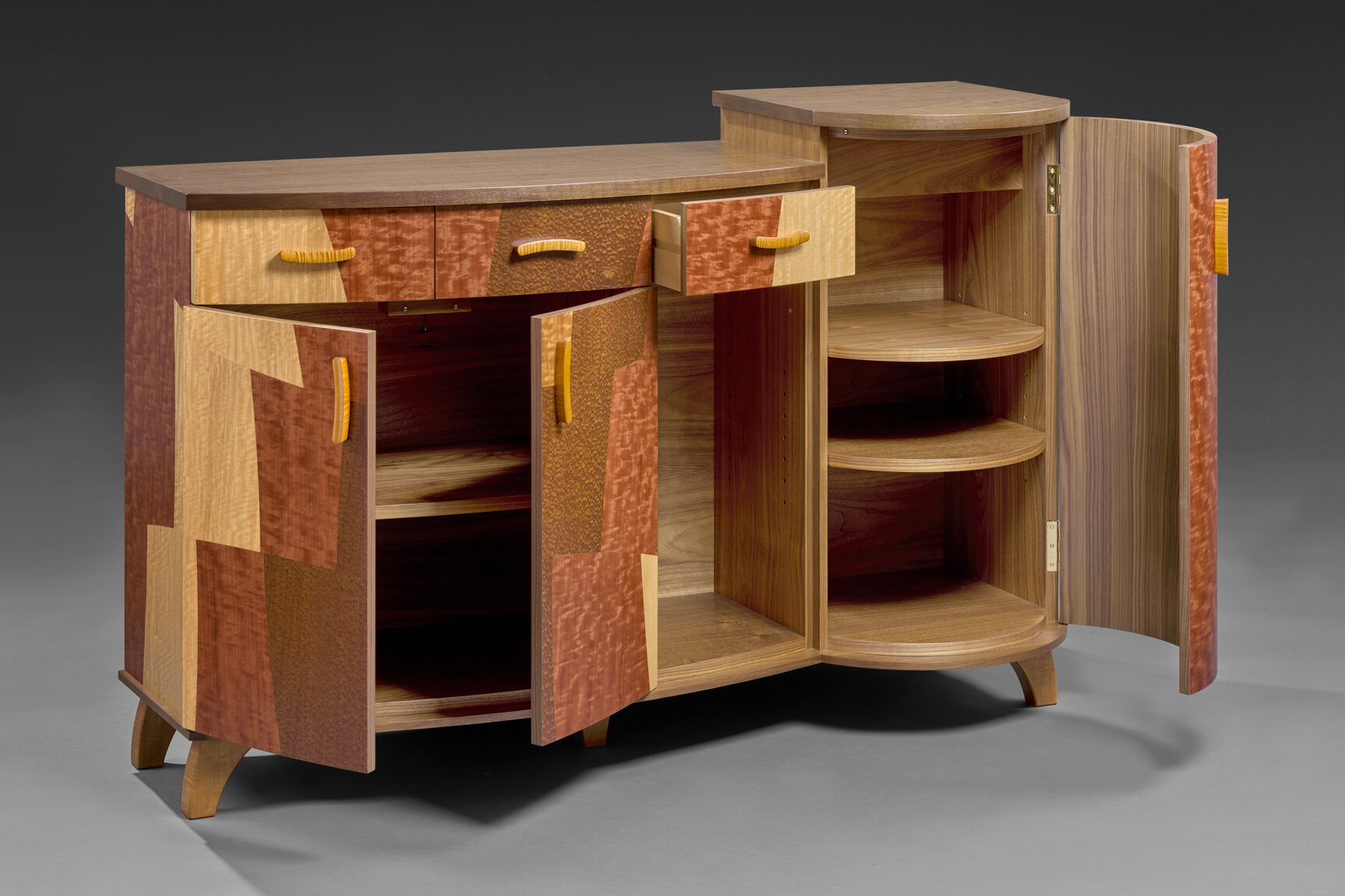 """Port Charlotte Console - American Black Walnut, Figured Anigre, Pomelle Sapele, Block Mottled Makore, Curly Maple 38""""H x 60""""W x 19""""DDetail of drawers and shelves."""