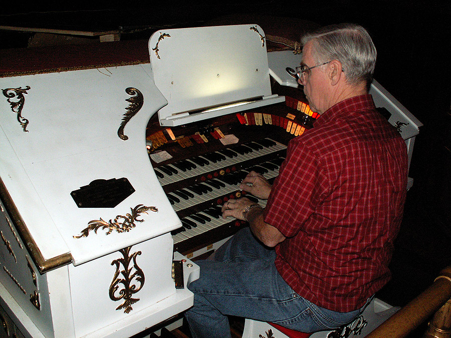 """Here - Chapter member Frank Evans is testing the organ after some repairs. This is the console of the Temple's Robert Morton 3/8 Theater Organ. Noted as a """"3/8"""" as it has three full keyboards - controlling 8 """"ranks"""" or voices of pipes."""