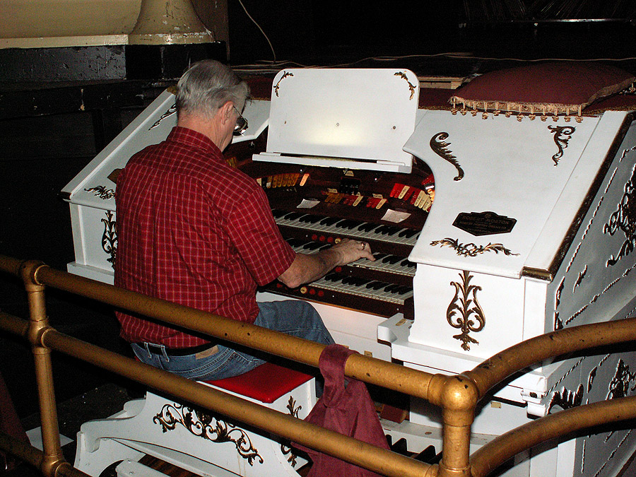 Frank Evans testing the organ after a repair.