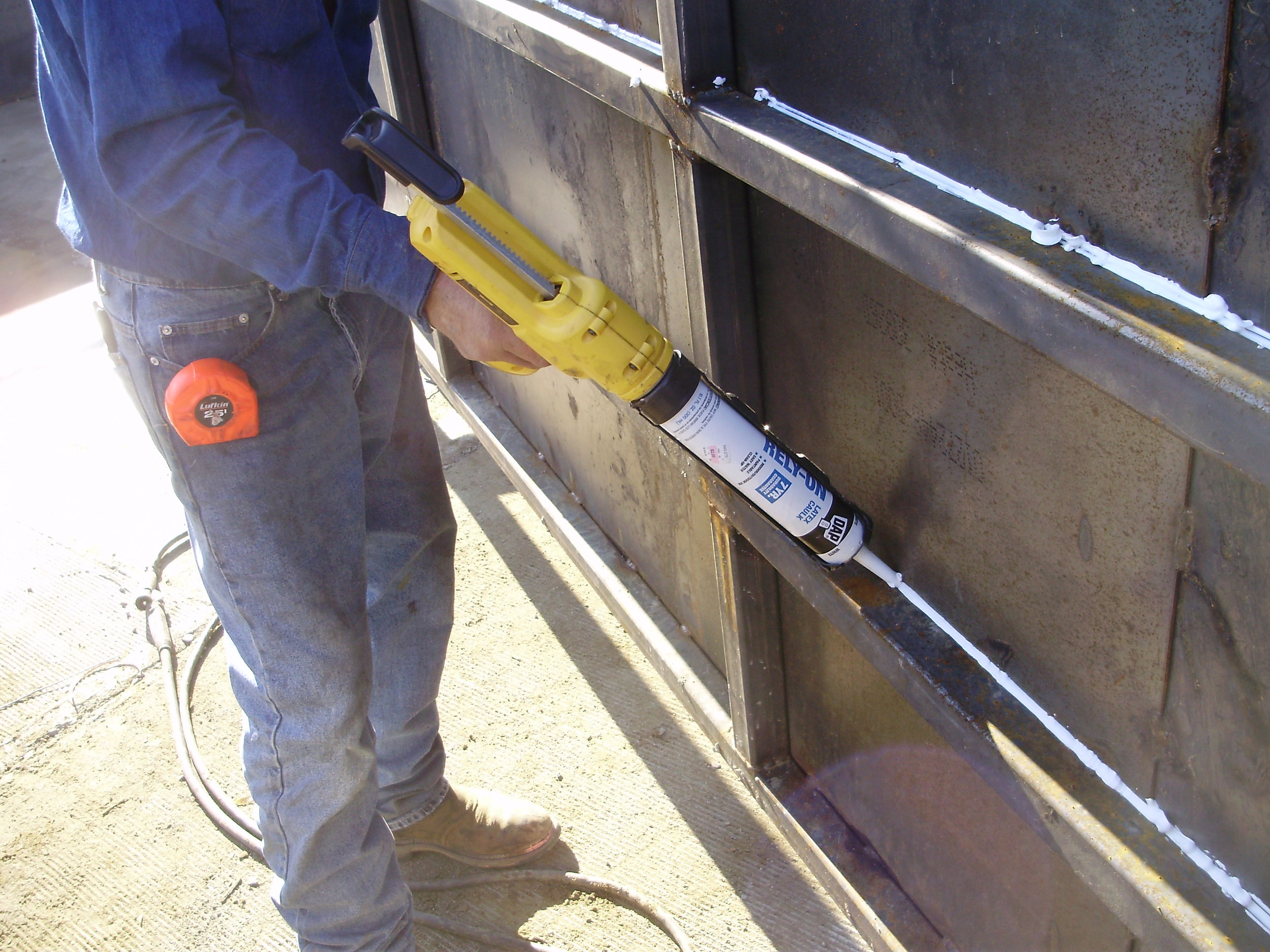 using silicone caulking on a gate