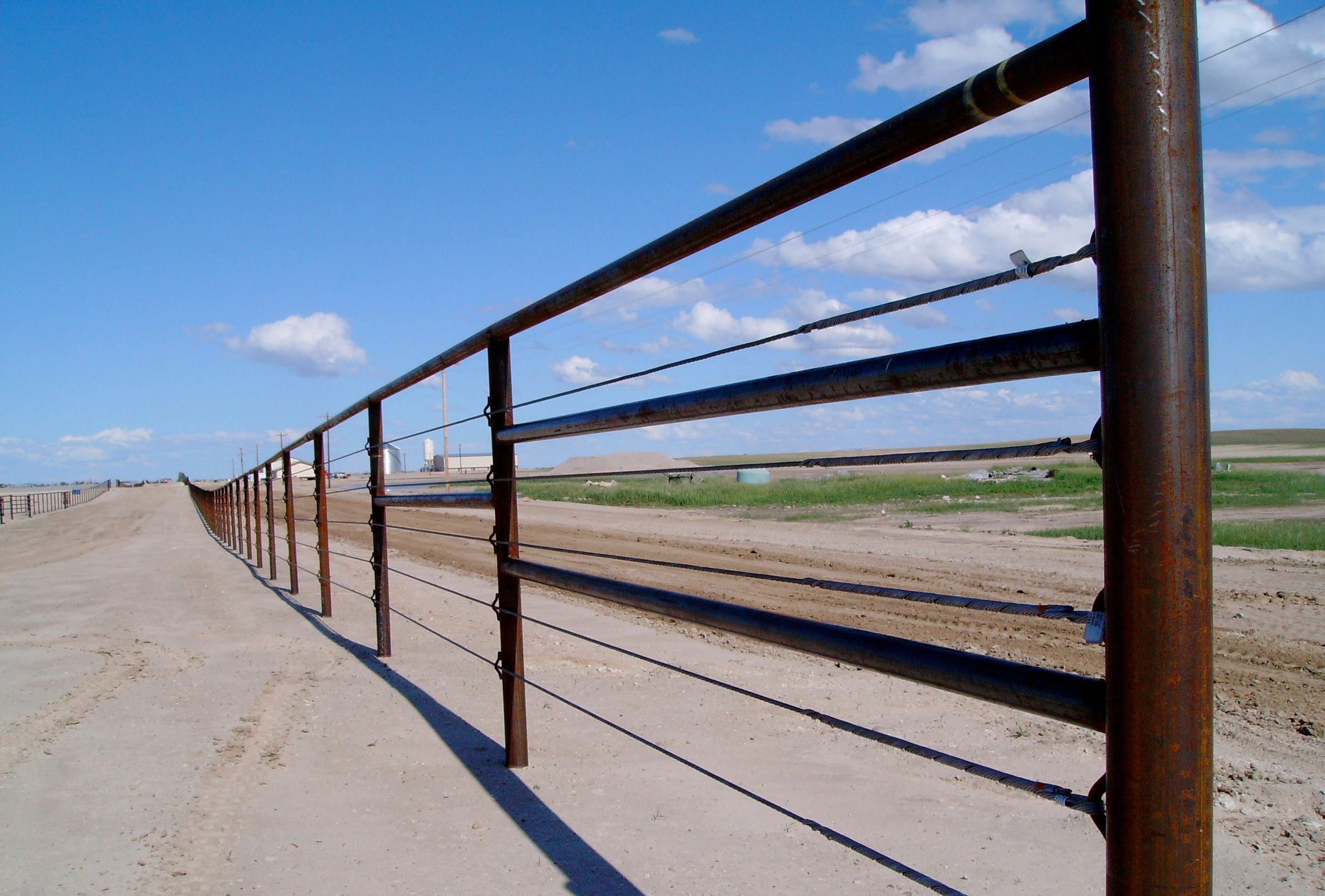 A long stretch of cable fence.