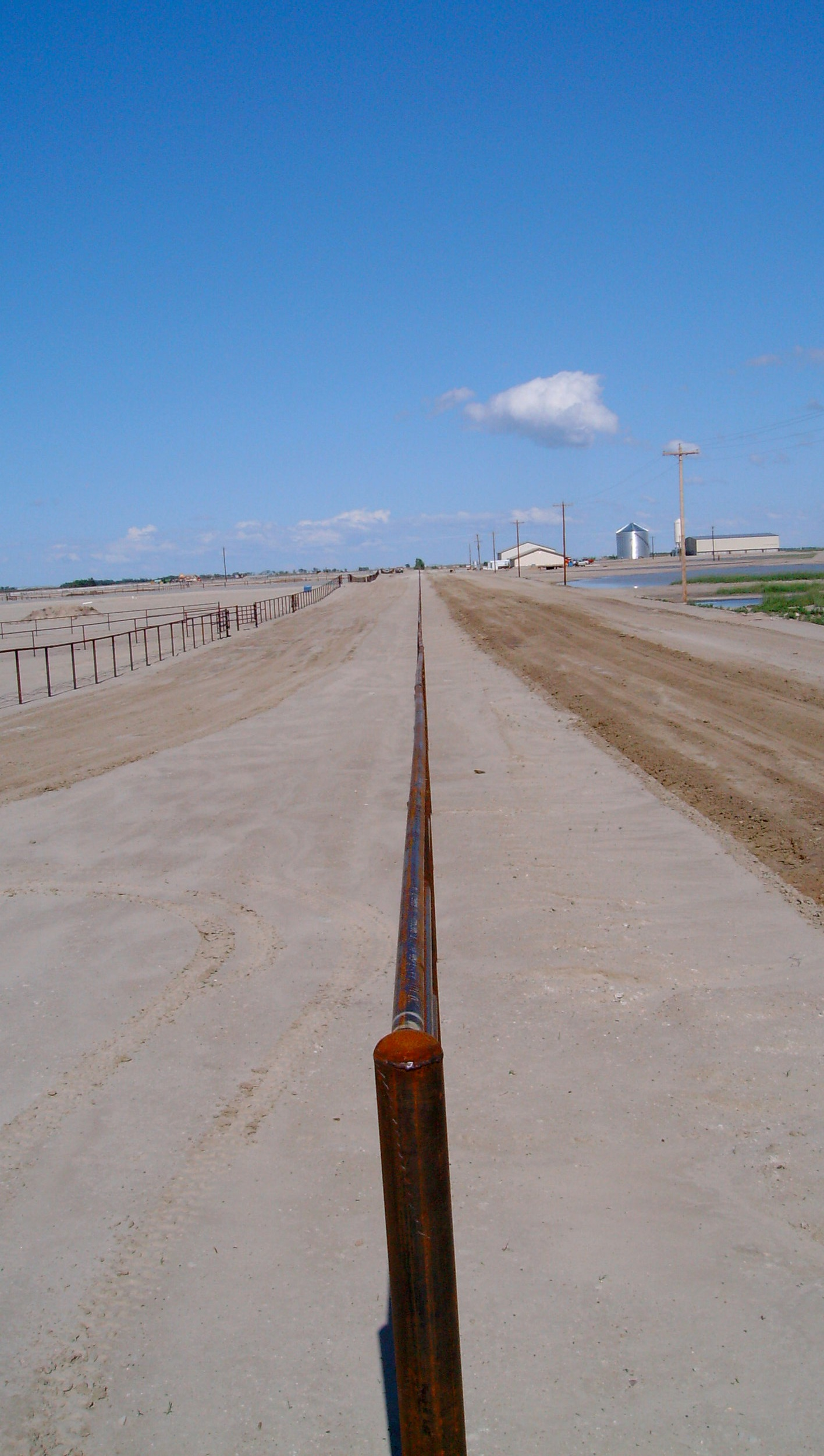 The top rail on long stretch of cable fence.