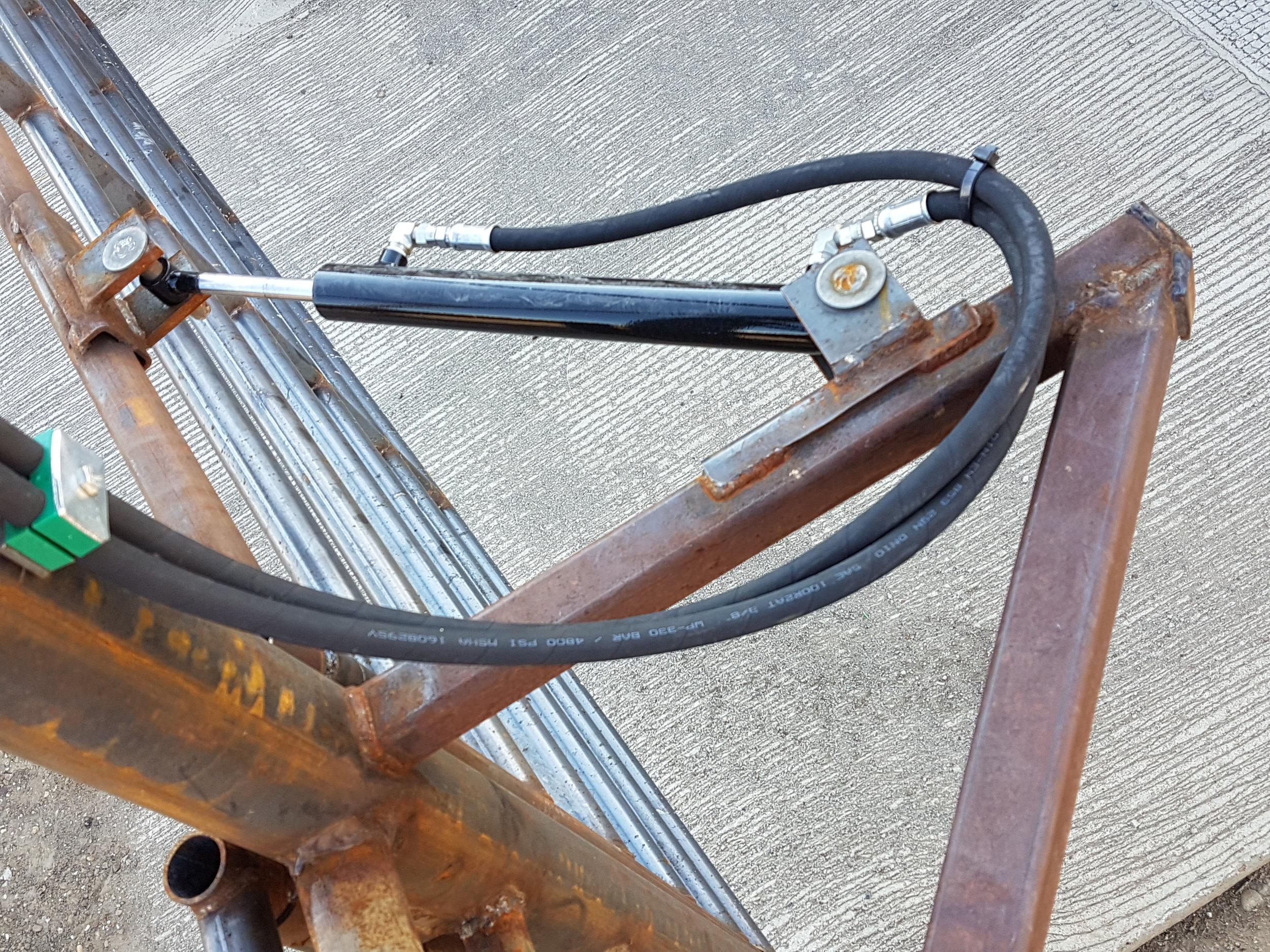 Hydraulic cylinder on a gate.