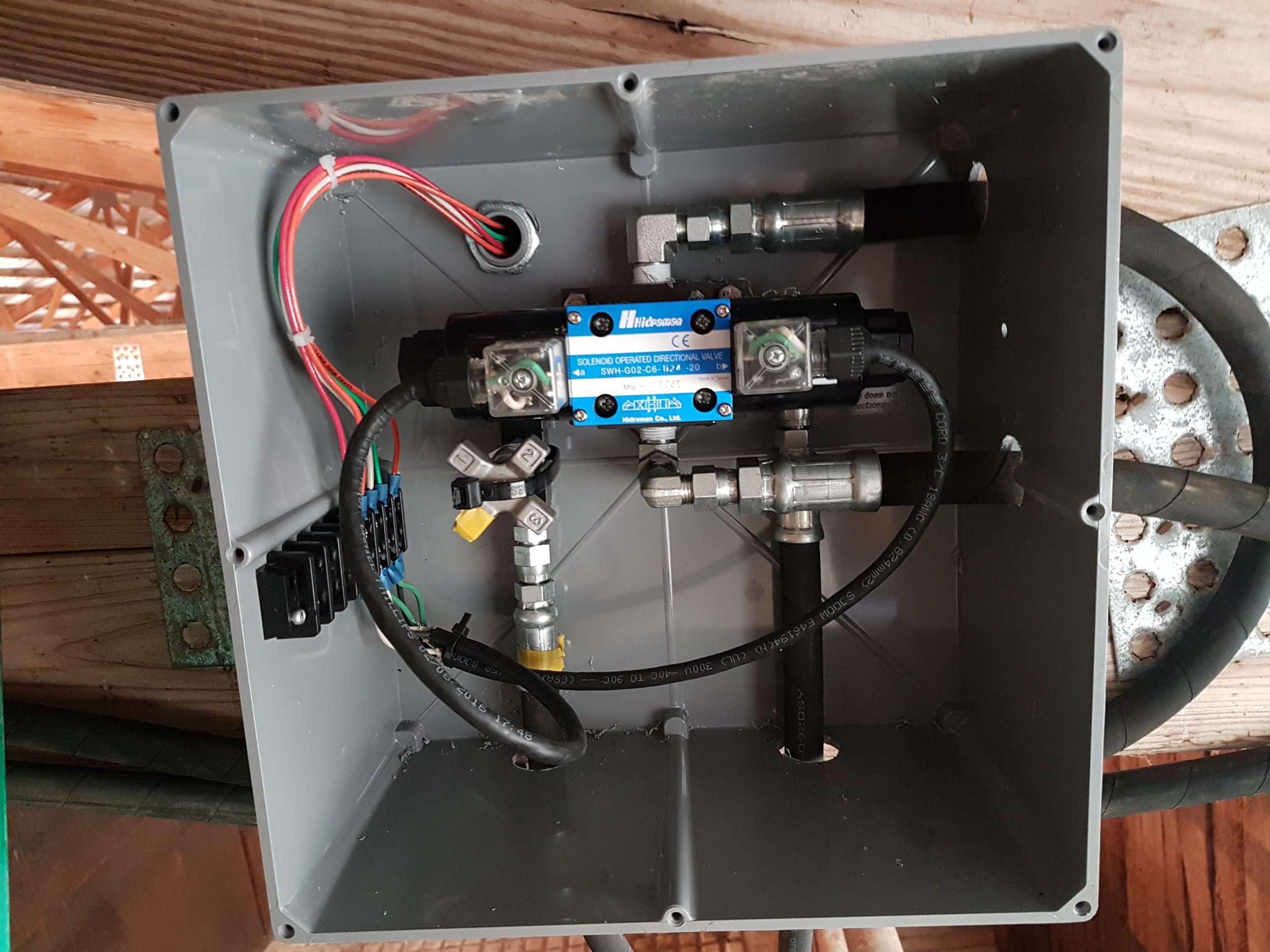 Electric valve inside a 12 x 12 PVC box.
