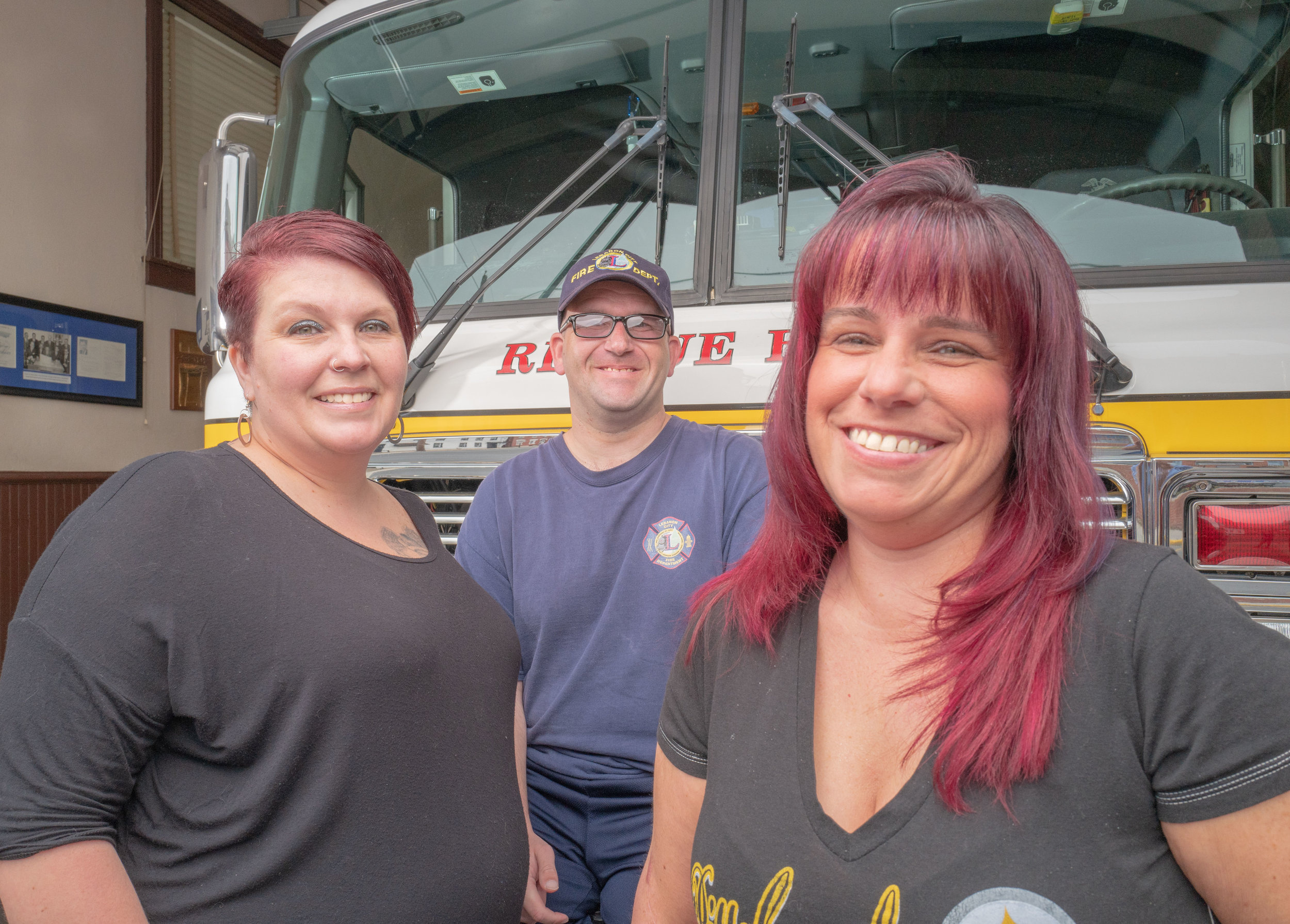 Heather(left) and her brother and sister at a fire house where their dad served.