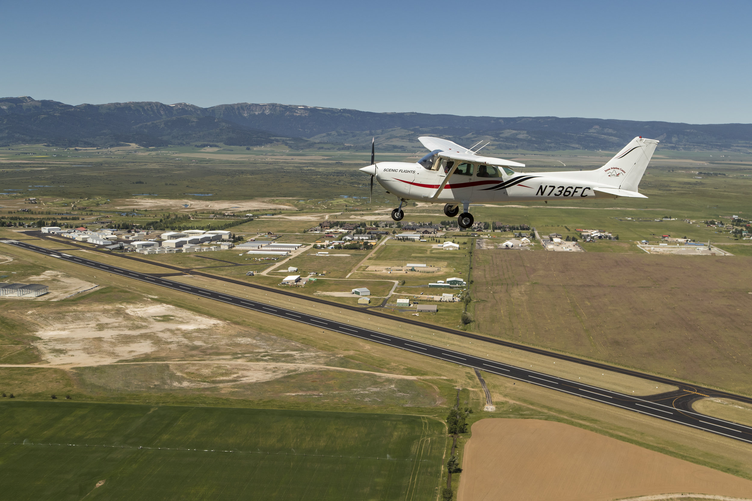 cessna flying over driggs airport fbo