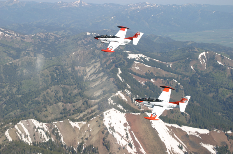 Two North American T-2 Buckeye's flying over mountains