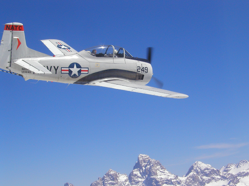 North American T-28 Trojan flying over tetons