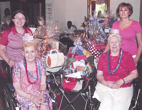 The Resident Council at  Bear Hill Rehabilitation and Nursing Center  in Stoneham, Mass. held a raffle to raise money for The Wounded Warrior Project which benefits American veterans and their families. The prizes were a variety of spectacular baskets created by the staff of Bear Hill. Pictured above are ( left to right ) Bear Hill Activities Director Marie White, Resident Council President Nina Raia, resident Elinor Roden, and Director of Nursing Peg Archidiacono, RN.