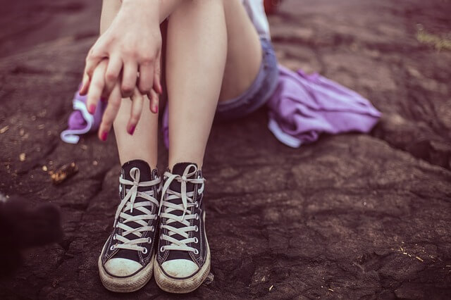 Legs and Converse sneakers