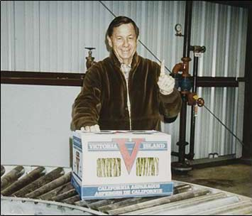 "Graydon ""Nic"" Nichols Celebrates the First Package of Victoria Island Farms Asparagus in 1987."