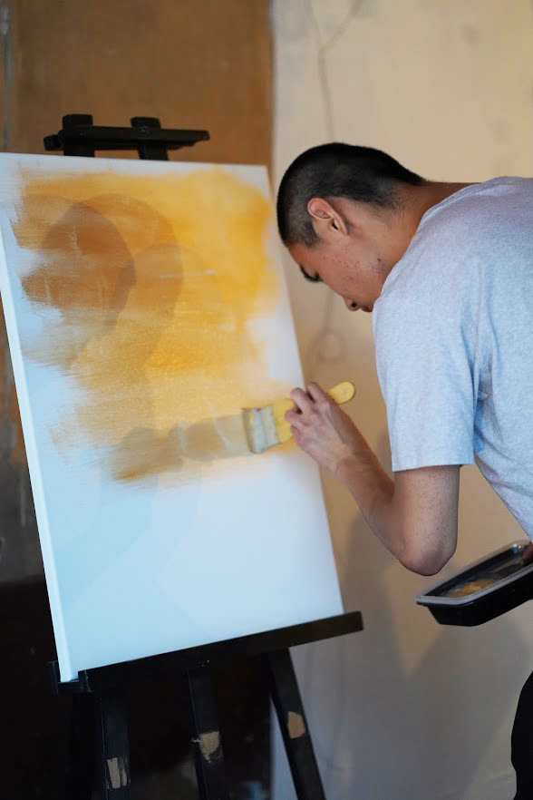 Live painting by artist-in-residence, Eugene Woo