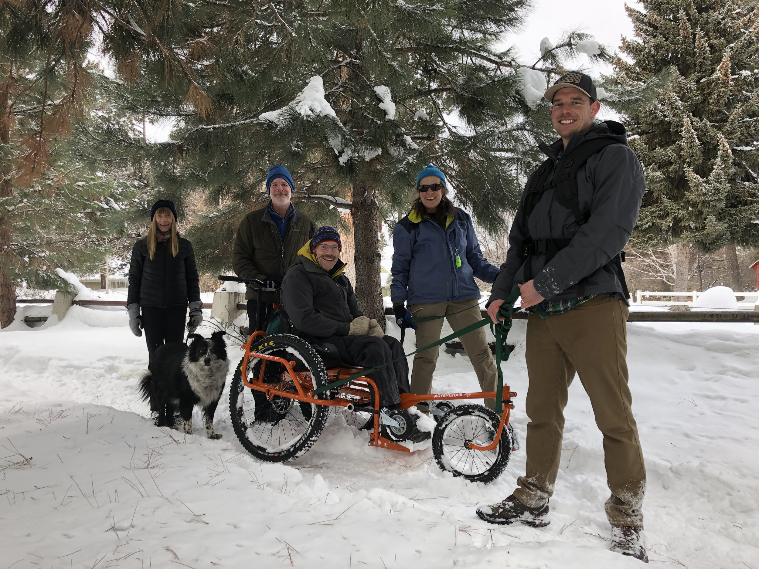 The team tests the two foot snow dump on the Canal Trail with the AdvenChair