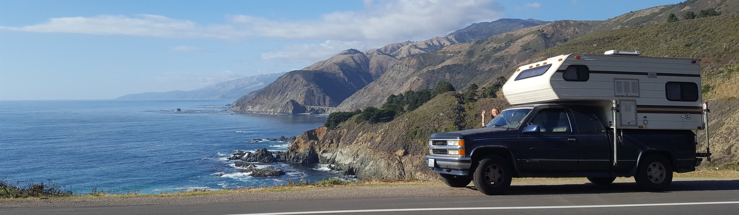 Truck and camper next to the Pacific ocean