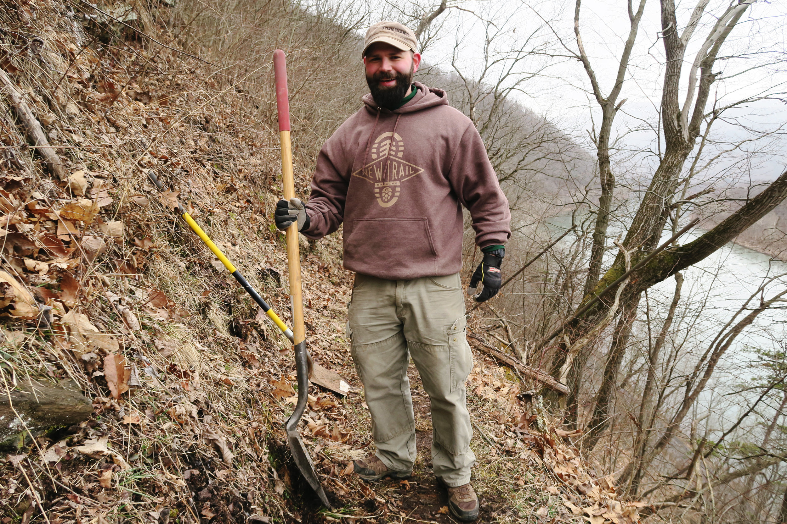 Our New Trail friends digging alongside the PA Trail Dogs at one of our Hyner work days.