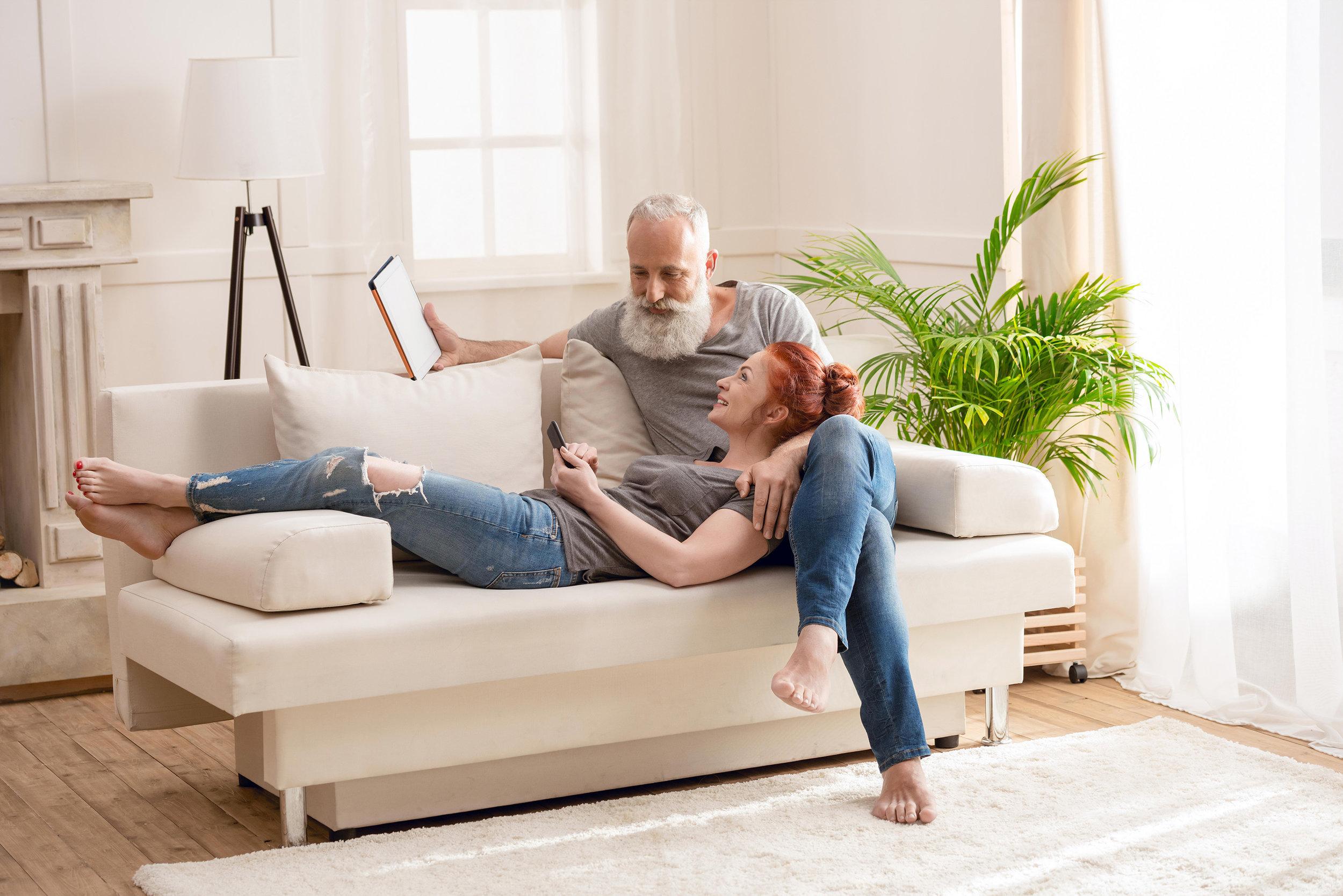 couple-relaxing-in-clean-living-room.jpg