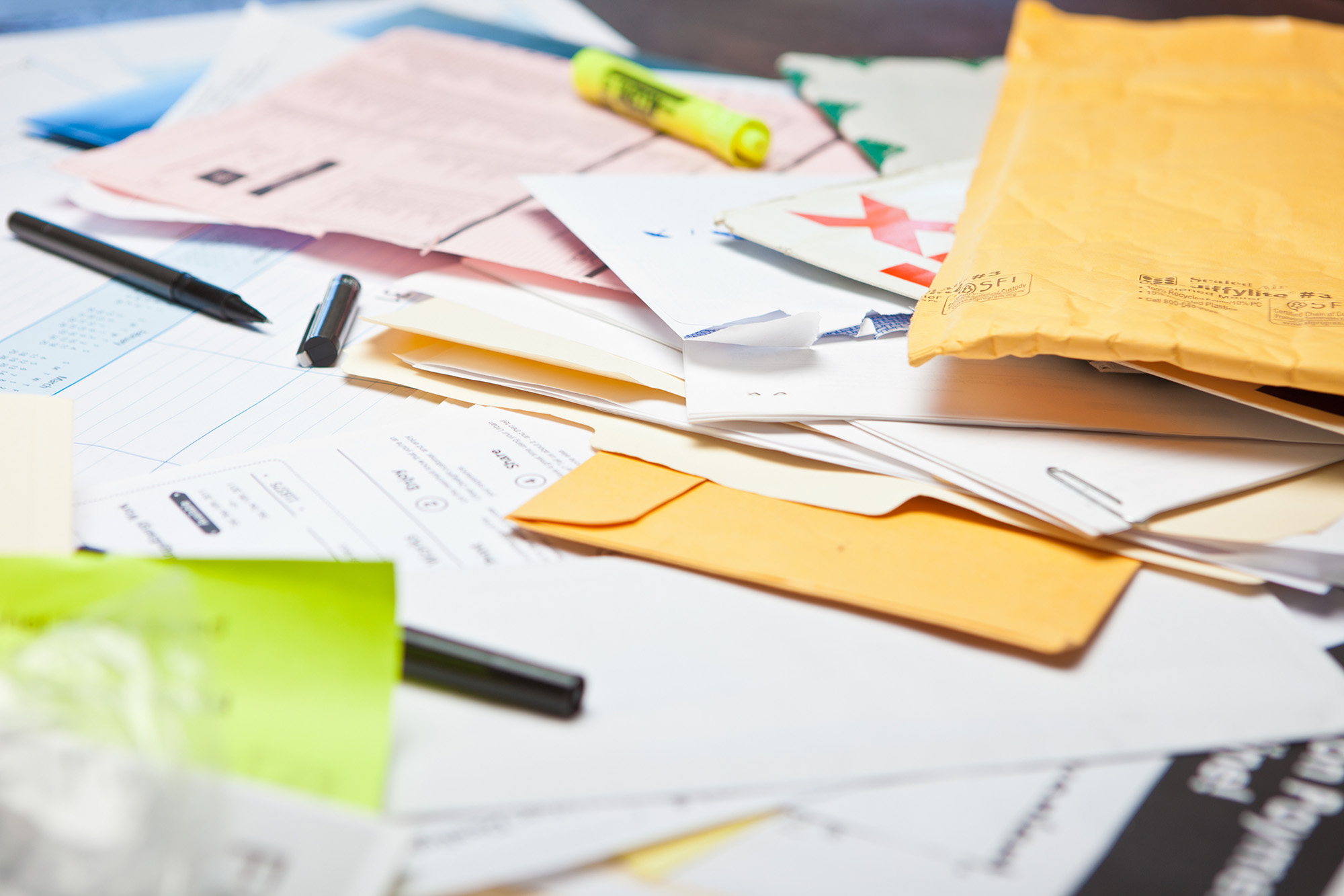 Cluttered-documents-papers-on-desk-SMALL.jpg