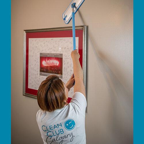 3.Using-mop-to-wash-walls-square.jpg