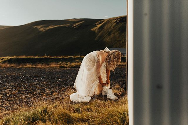 "This is an 100% authentic moment. Brittney slipped into her gown, tied her boots, and put her earrings on behind an old shed in Iceland before saying ""I do."" Her groom waited right around the corner from her with his back turned and nerves high. They were both beaming with excitement and a joy I can only imagine comes from running away to another country with the love of your life and professing your love to one another. I still can't believe I got to be apart of this. I can't believe how exhilarating it felt to get to witness the way these two loved each other. It's all they needed. It's all the really wanted. Each other. . . . . . . . . . . . . . #loveauthentic #intimateweddingphotographer #heyheyhellomay #loveandwildhearts #momentsovermountains #woodsywedding #wildelopements #justalittleloveinspo #hippiebride #radlovedstories #elopementcollective #theknot #adventurephotography #unconventionaltogs #firstsandlasts #pnwwedding #wedventuremag #elopementlove #elopementphotographer #authenticlovemag #whyweadventure #raleighphotographer #raleighwedding #ncwedding #belovedstories #creativehappenings #loveanimals #wanderingphotographers #adventurouswedding #destinationweddings"