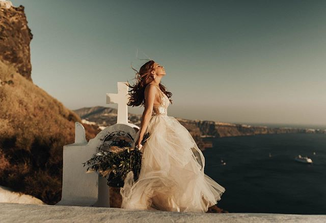 Just know I was screaming when I took this picture bc Gabby is queeeeeen and I honestly couldn't handle the amount of slay I was experiencing. So here I present Mrs. Yount on her wedding day, absolutely robbing Santorini of it's golden light and glory (I obvi enjoy hyping my brides). . . . . . . . . . . . . . #loveauthentic #intimateweddingphotographer #heyheyhellomay #loveandwildhearts #santorinigreece #santoriniphotographer #wildelopements #justalittleloveinspo #hippiebride #radlovedstories #elopementcollective #theknot #adventurephotography #unconventionaltogs #firstsandlasts #santorinielopement #wedventuremag #elopementlove #elopementphotographer #authenticlovemag #whyweadventure #raleighphotographer #santoriniwedding #ncwedding #belovedstories #creativehappenings #loveanimals #wanderingphotographers #adventurouswedding #destinationweddings
