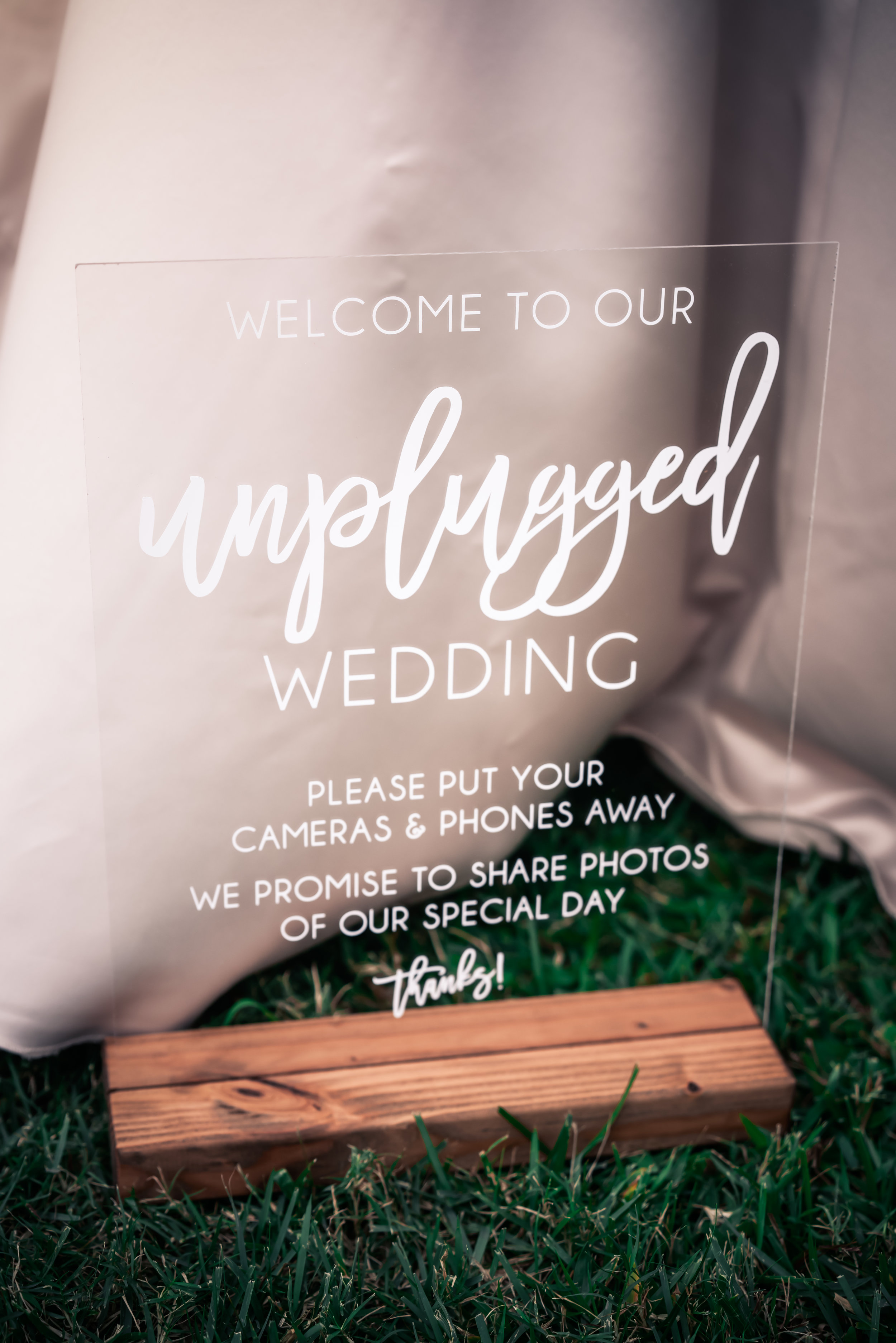 Rent our unplugged sign ($10) to politely let guests know to put away their cameras and phones during the ceremony.