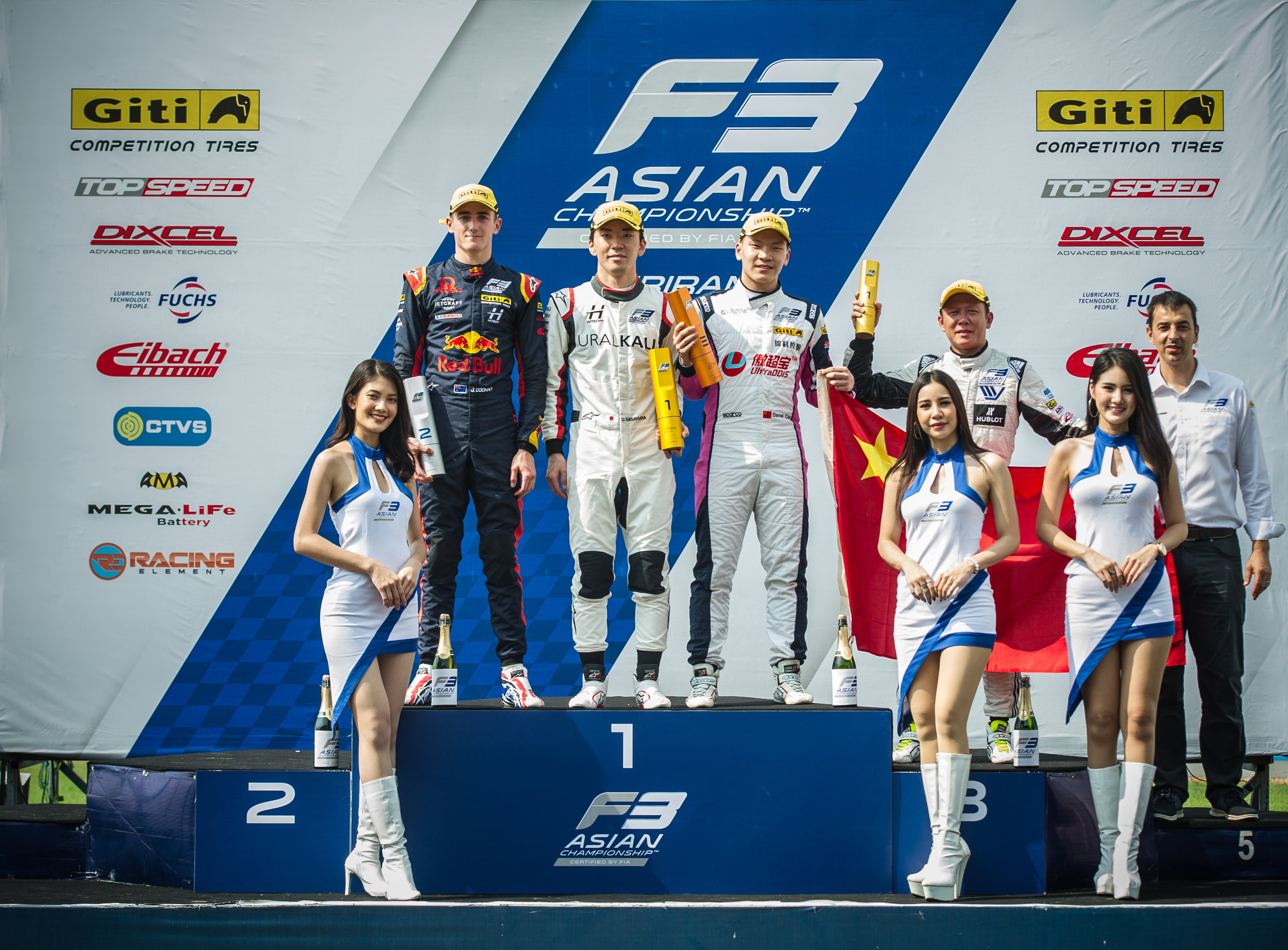 Ukyo Sasahara on the top step of the Race 4 podium.