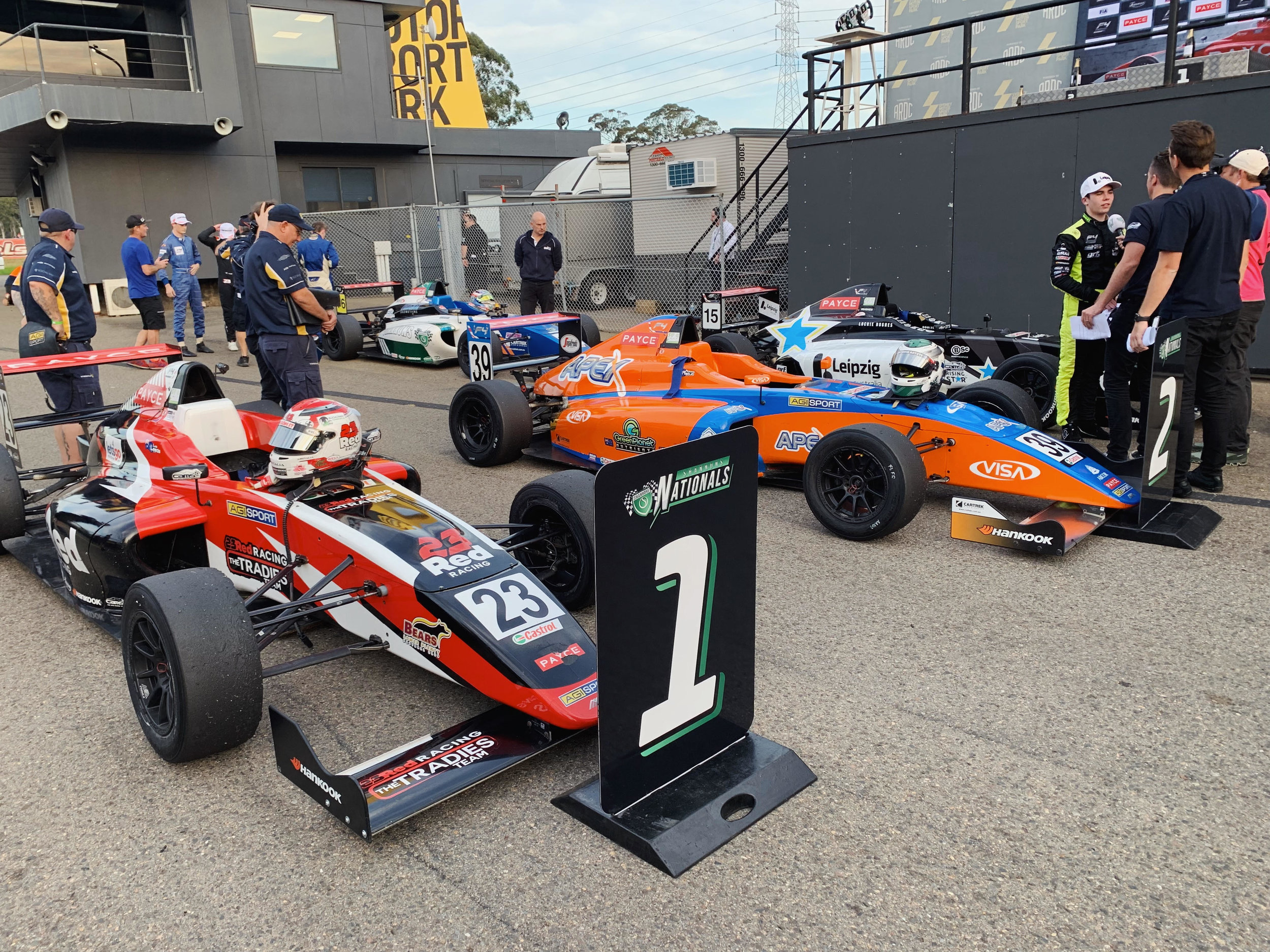 Parc ferme with the top 3 after the race.