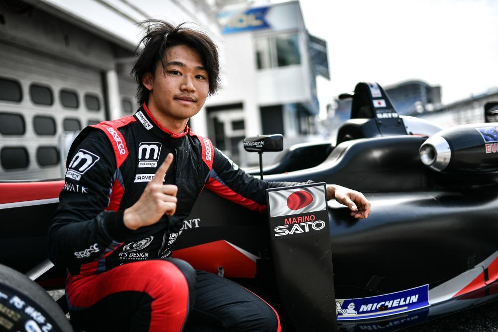 Marino Sato celebrates his pole position after qualifying.