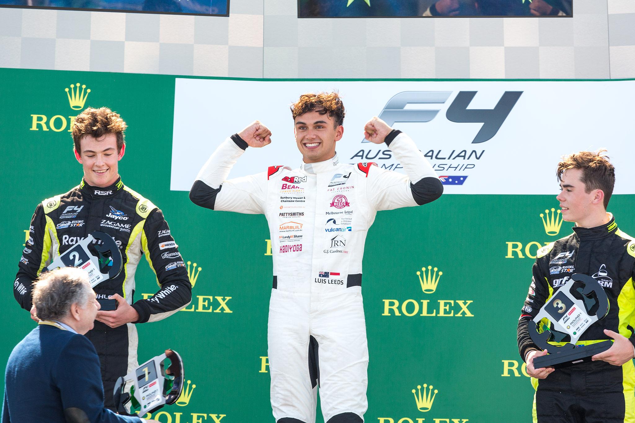 Luis Leeds celebrates a race victory at the Australian Grand Prix.